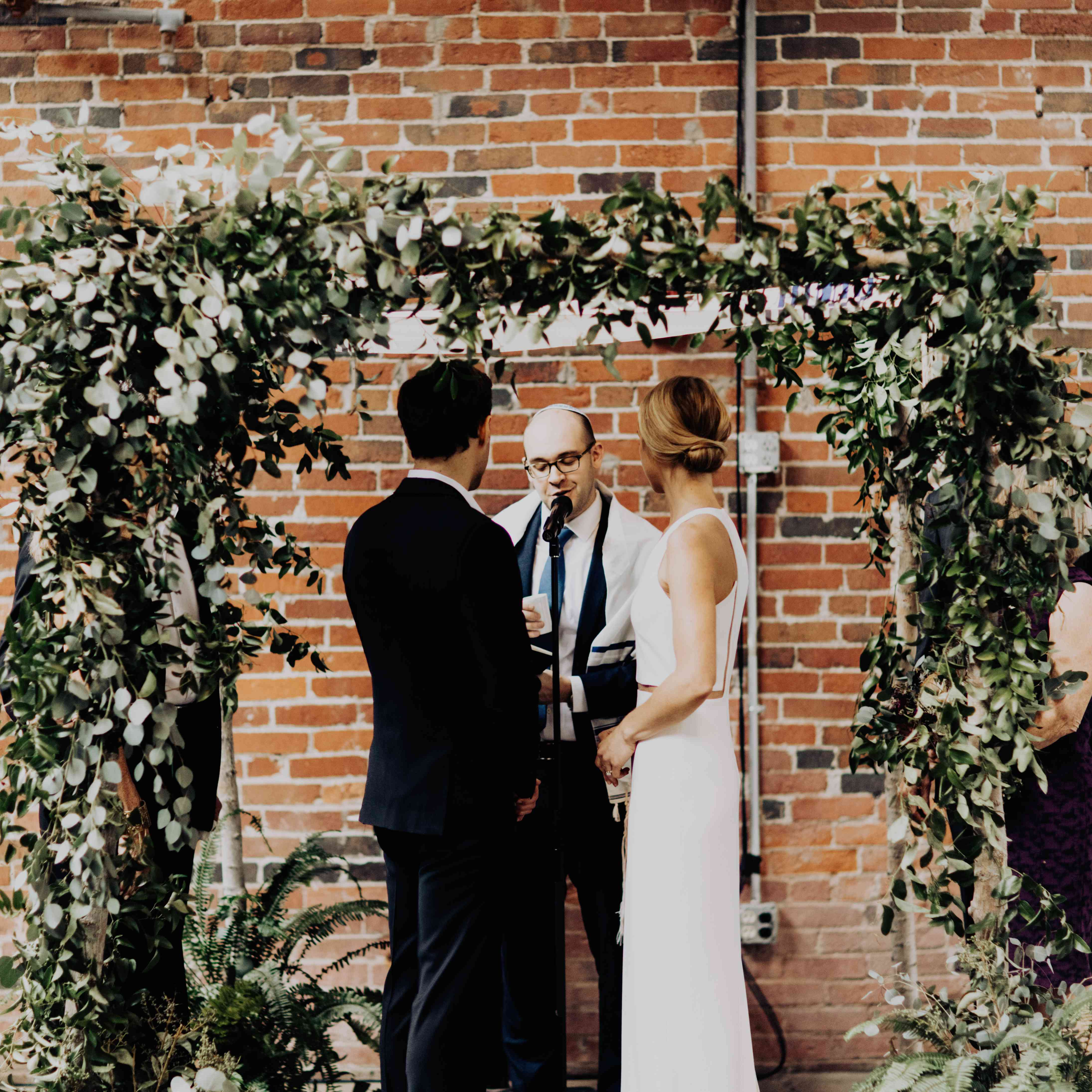 <p>ceremony greenery covered chuppah</p><br><br>