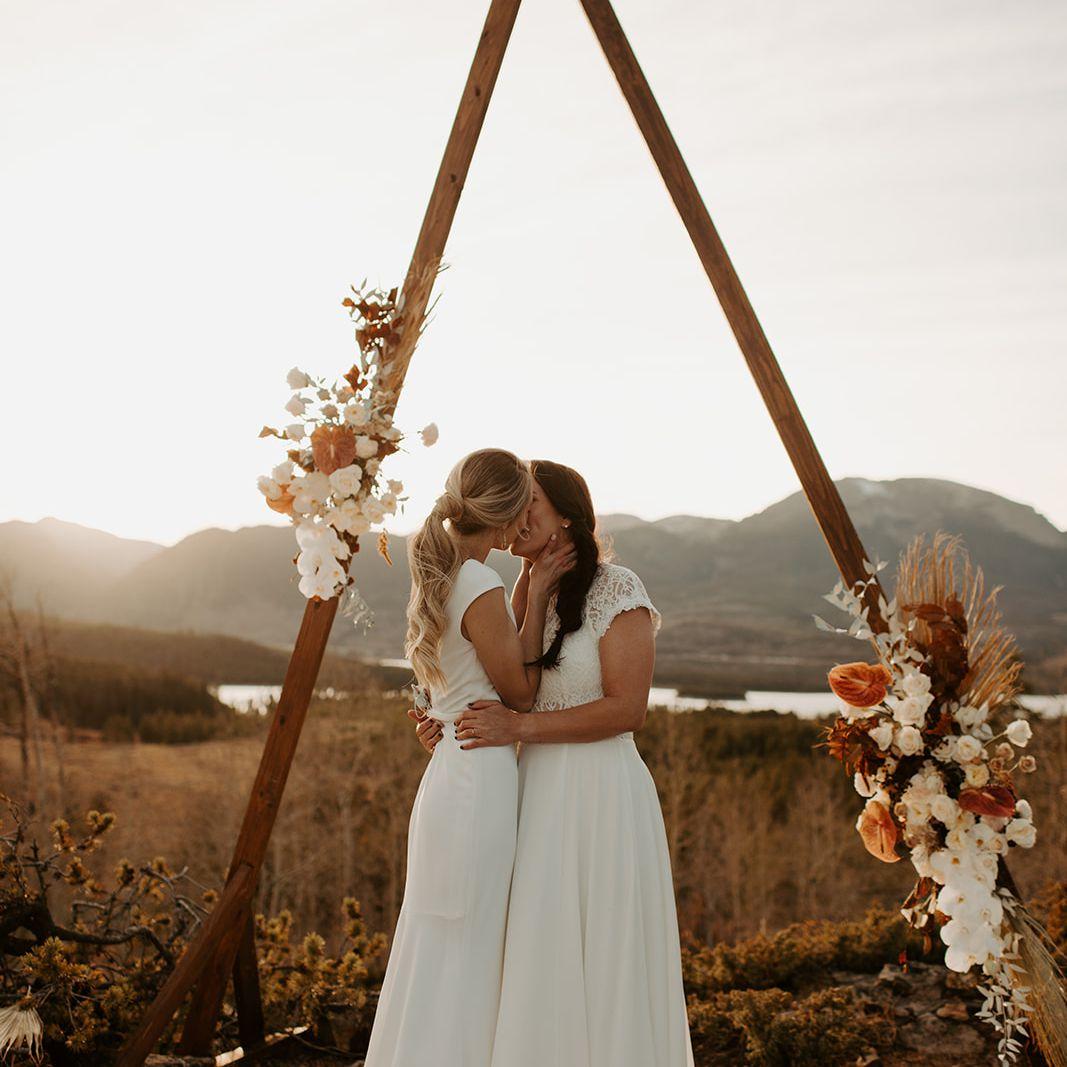 Brides kiss at altar