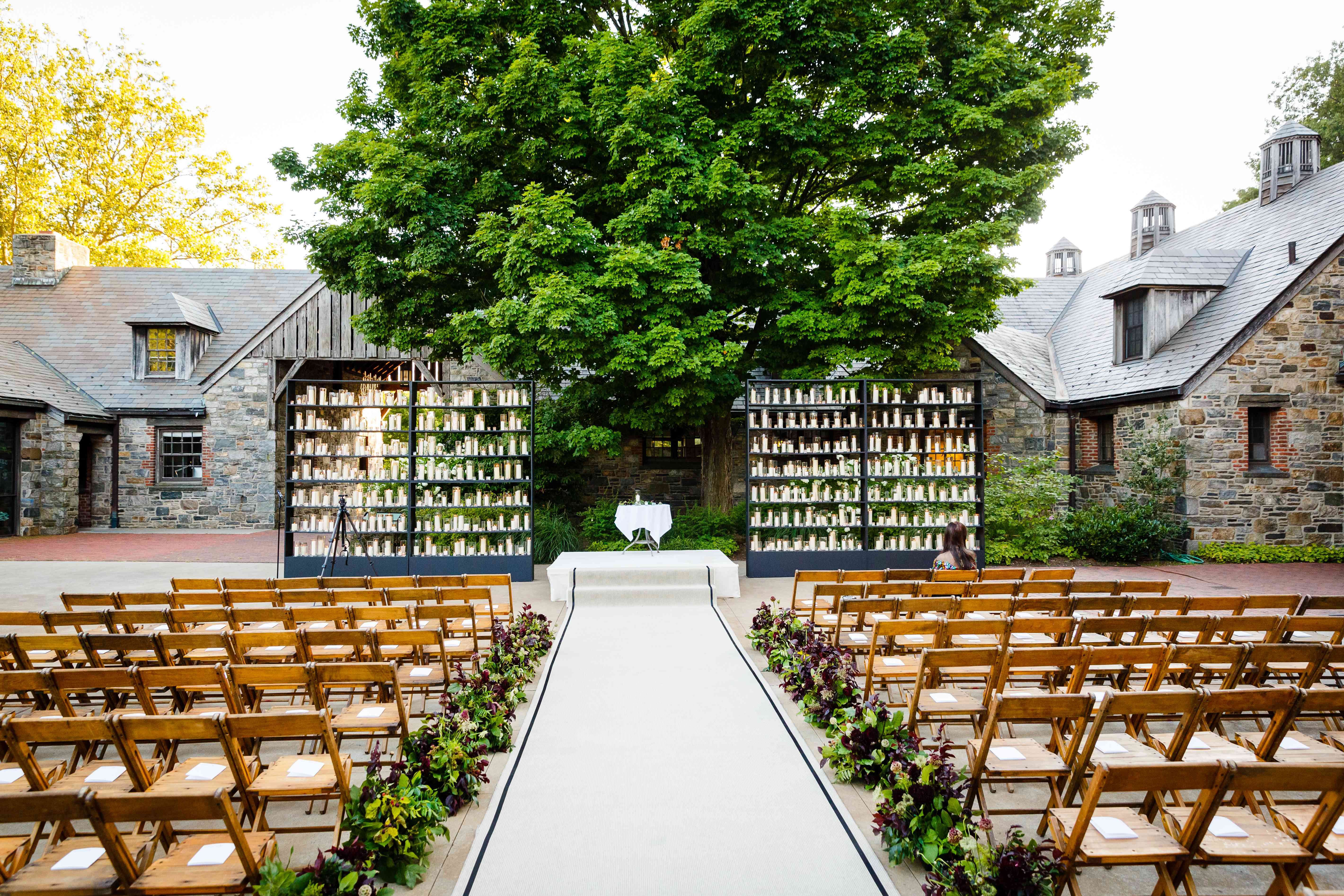 ceremony seating wood chairs candle covered bookcases