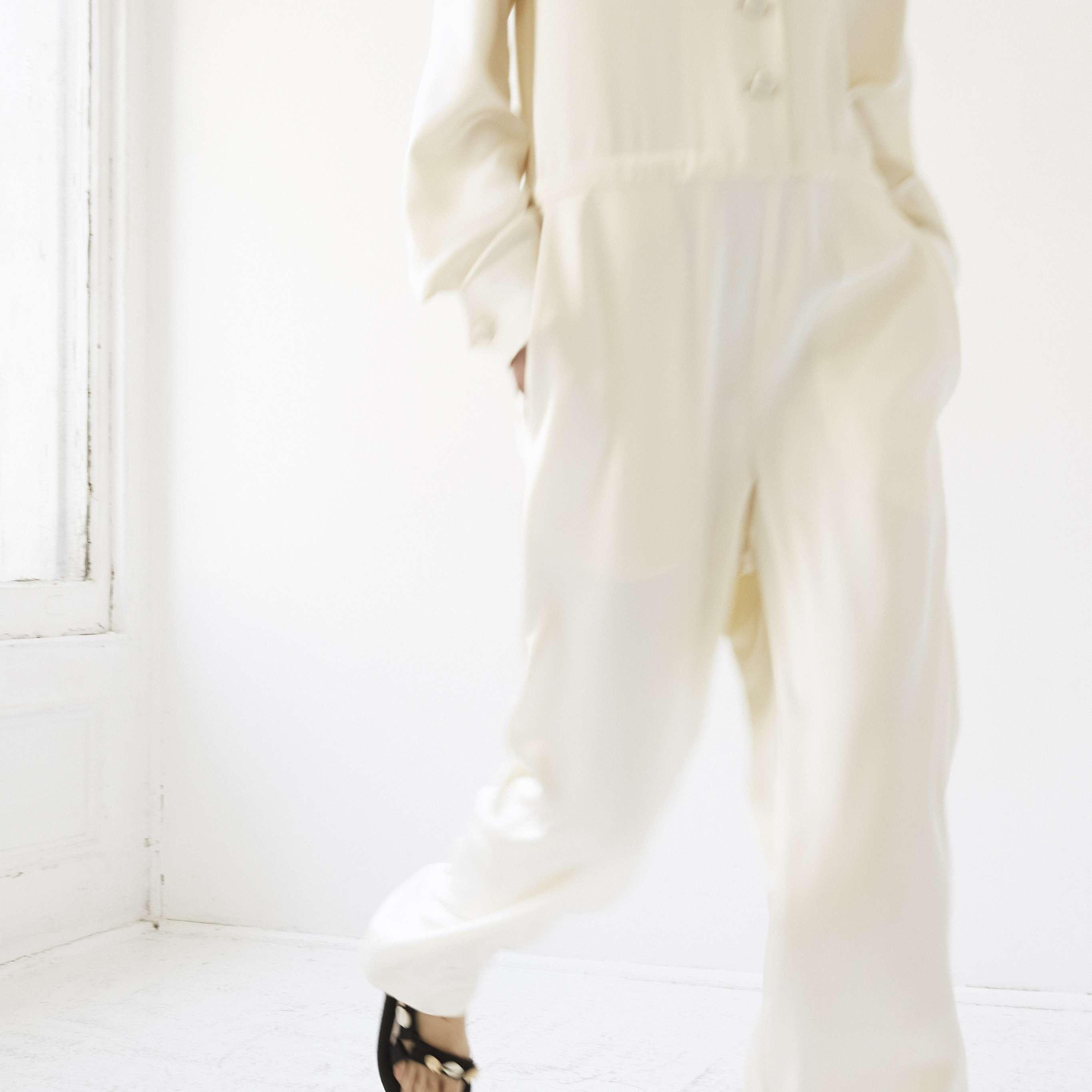 Model in long sleeve wedding jumpsuit