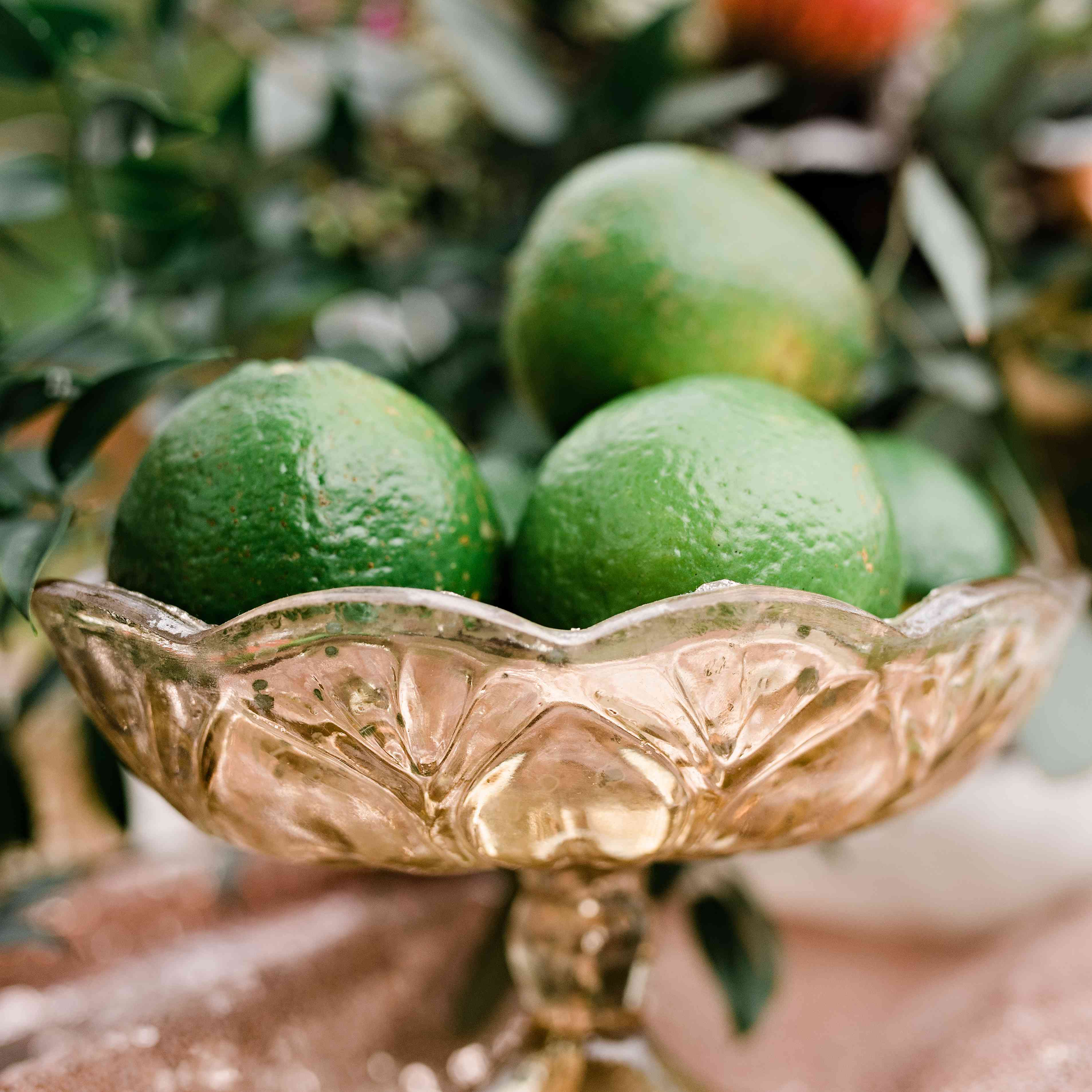 Limes in a gold dish as a centerpiece