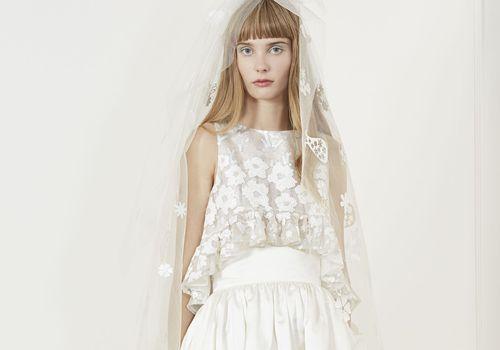 Model in crop top and high waist skirt