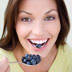 woman eating blueberries