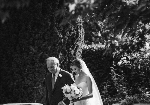 father of the bride walking daughter down the aisle