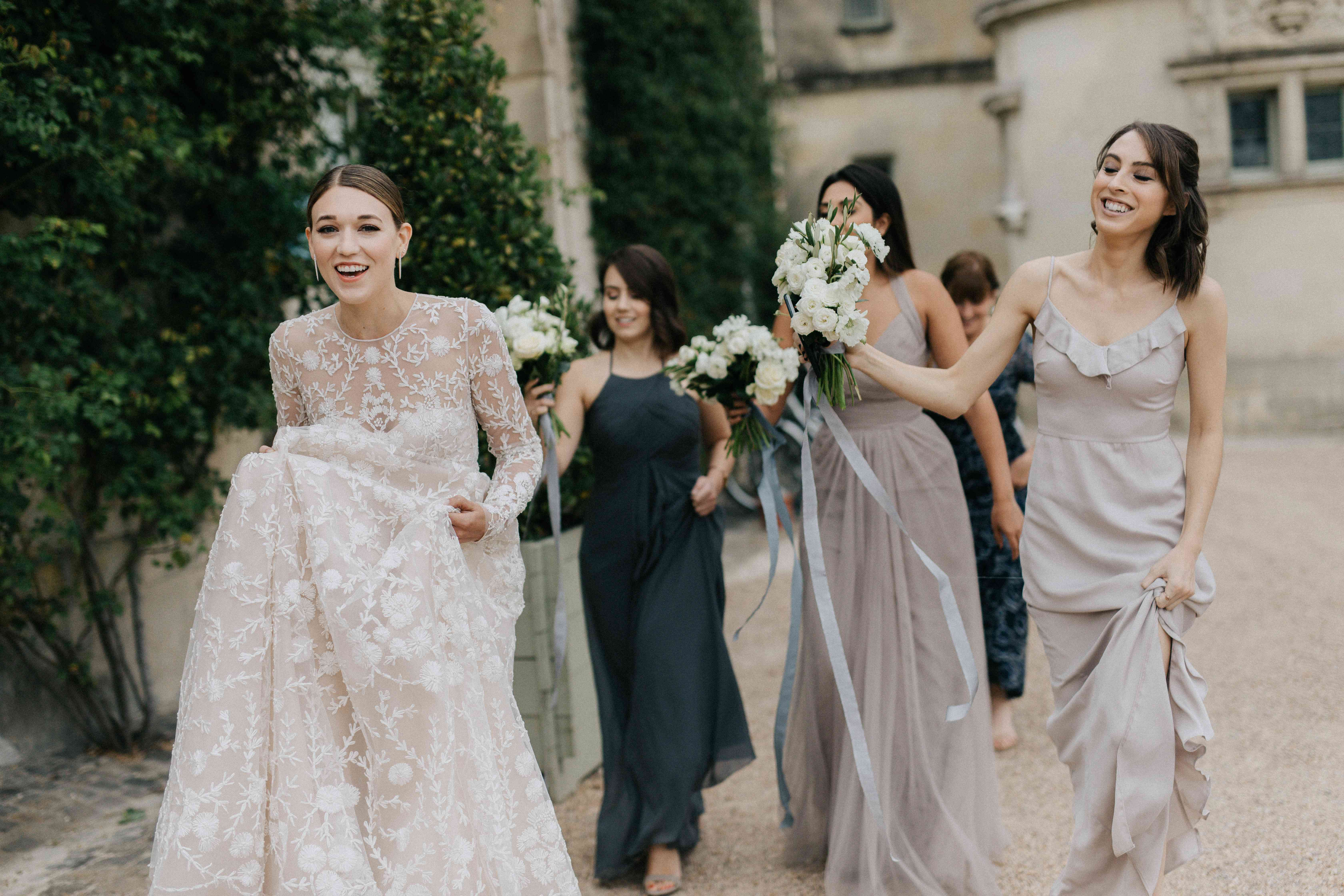 <p>mismatched bridesmaids dresses in shades of grey</p><br><br>