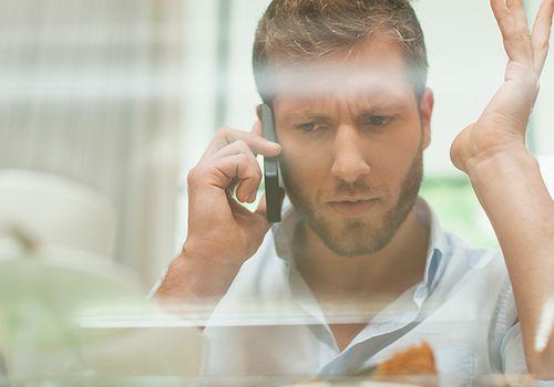 Irritated man on the phone
