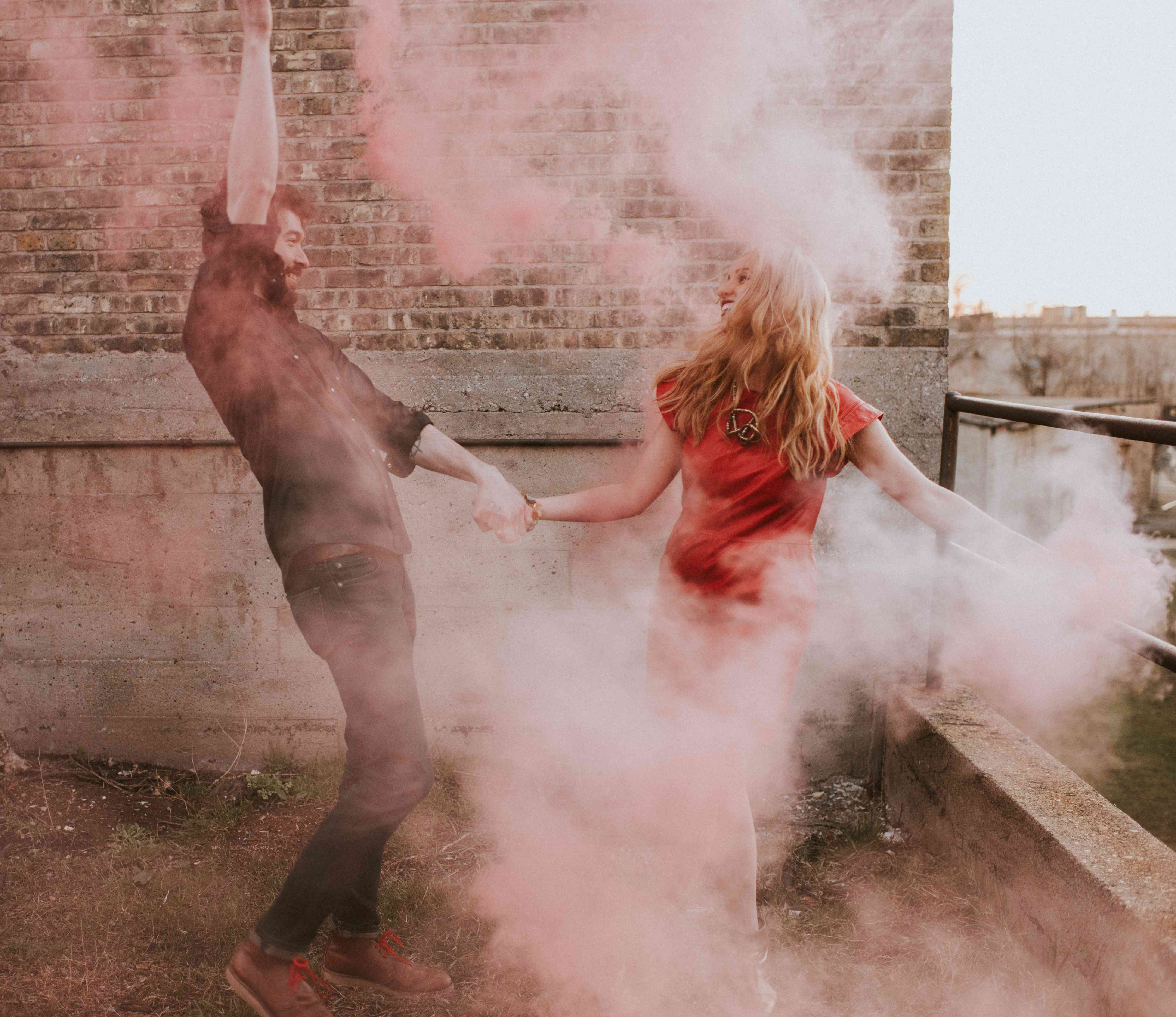 Couple with colored smoke