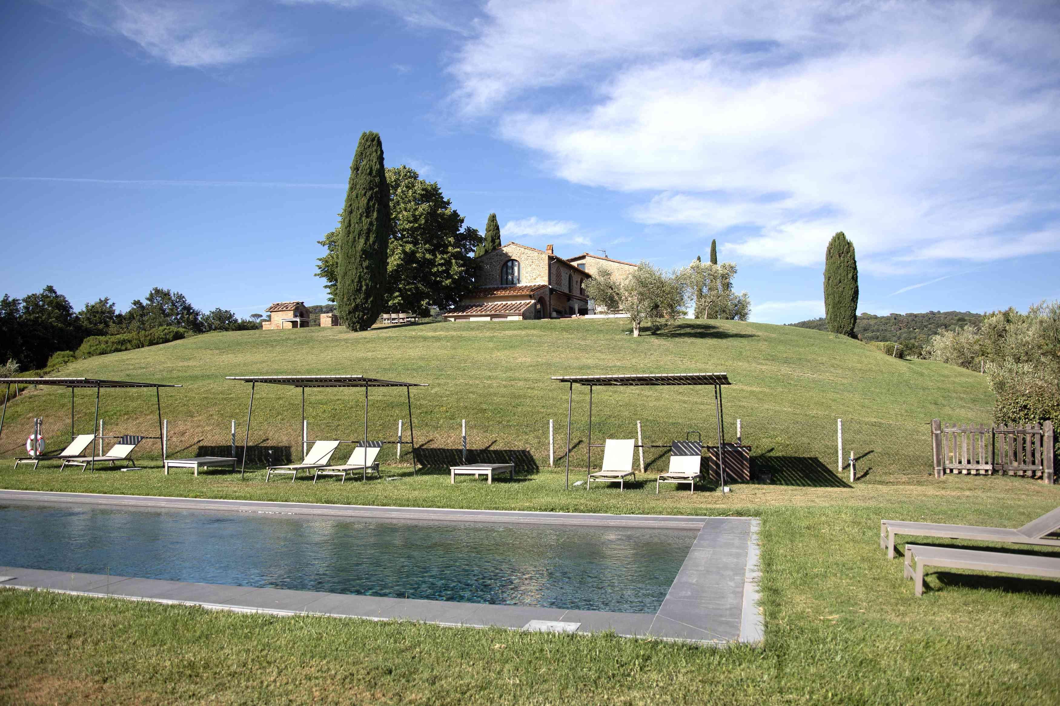 Pool and cabanas at Agriturismo Caseta in Tuscany