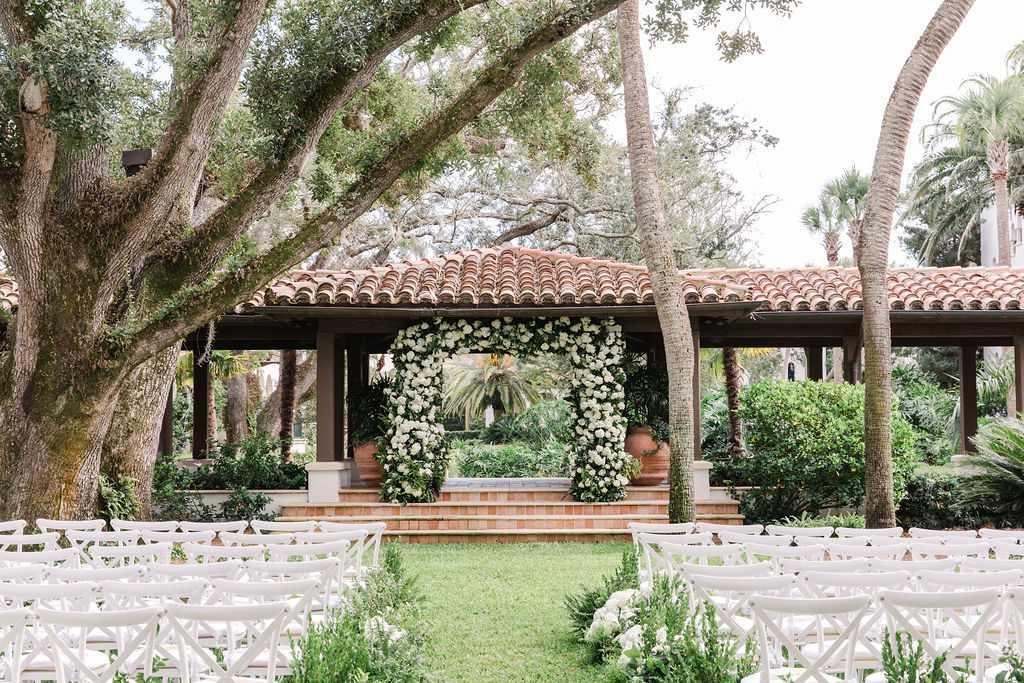 timeless southern wedding, outdoor ceremony flower arch