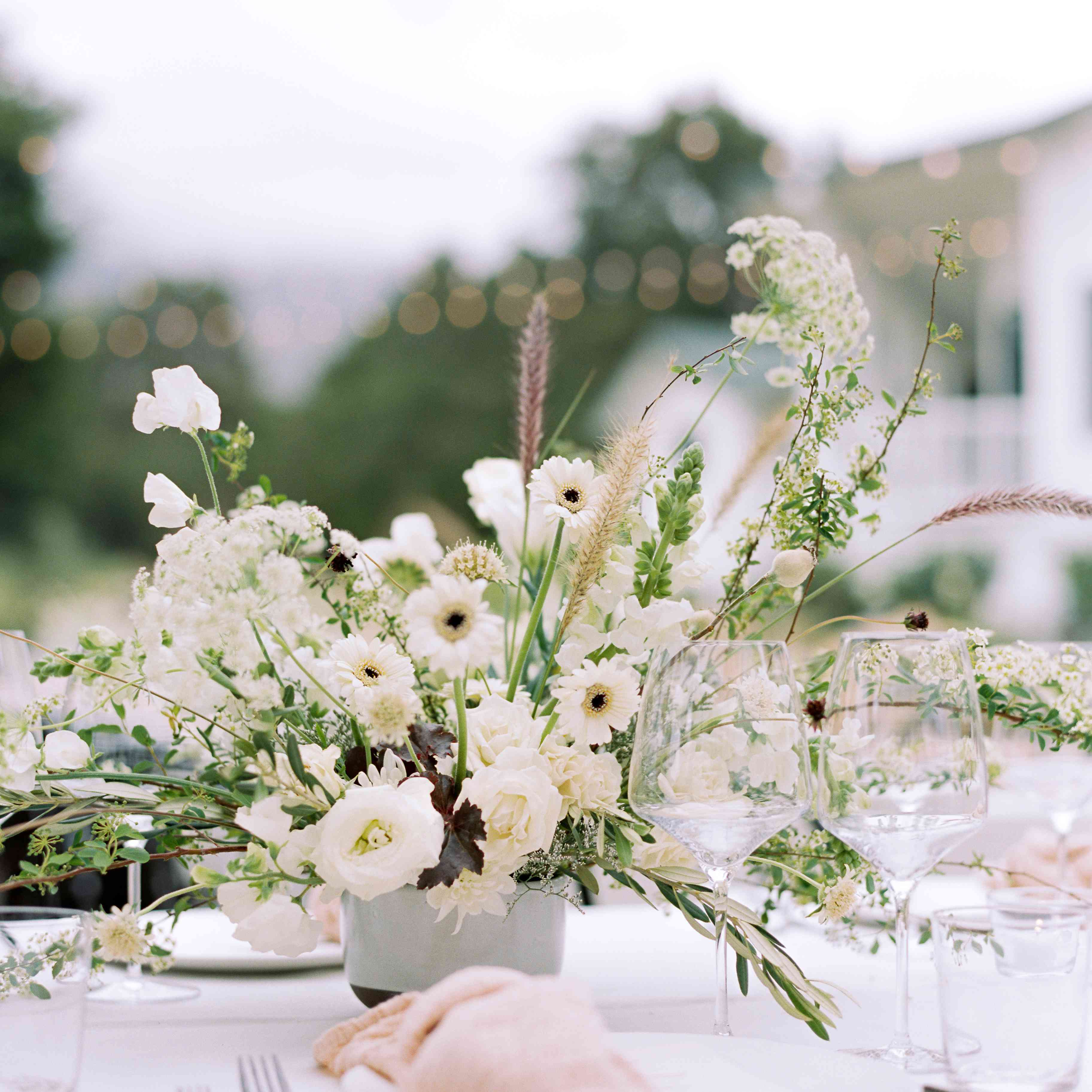 peach linens with neutral flowers reception