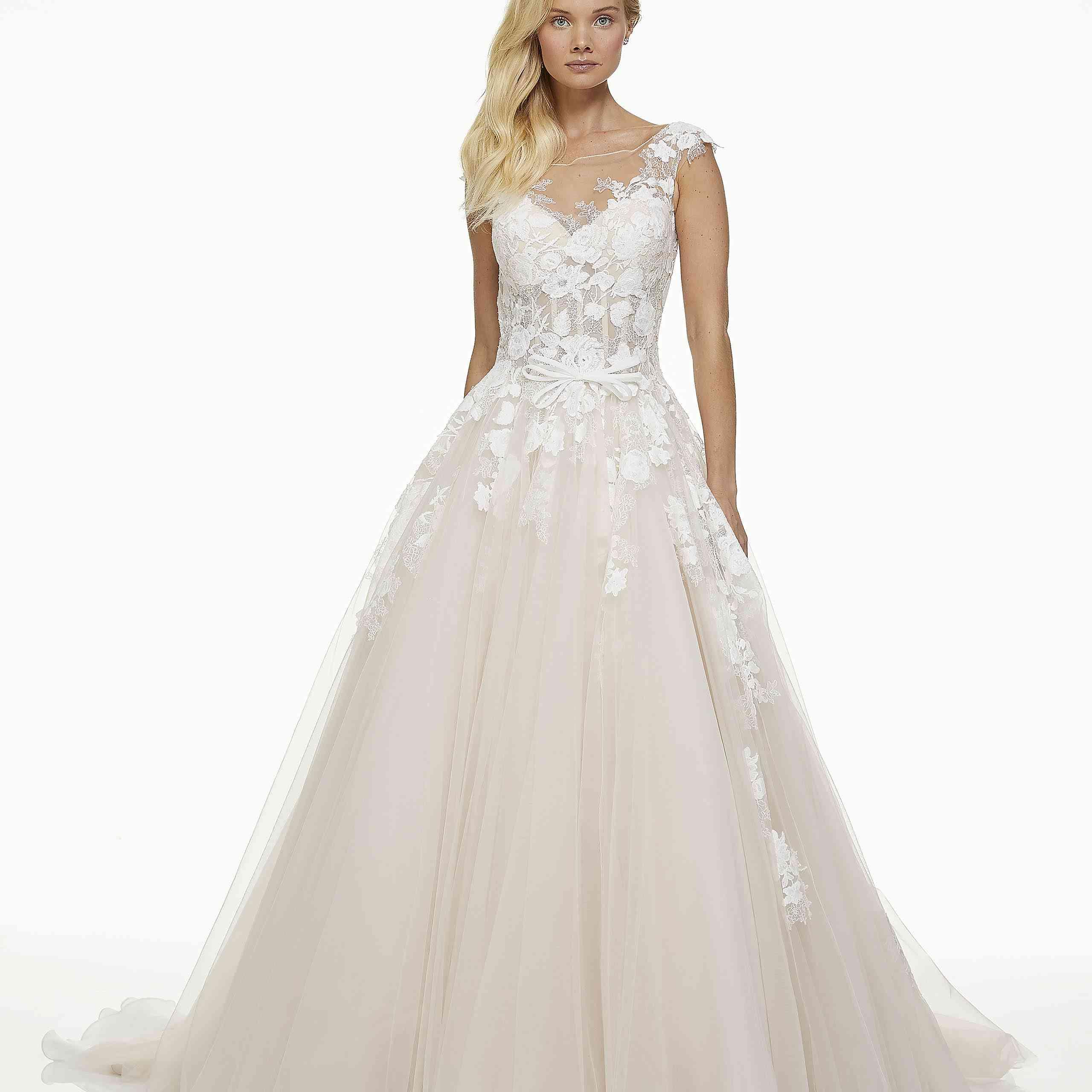 Model in bateau neckline lace wedding ball gown