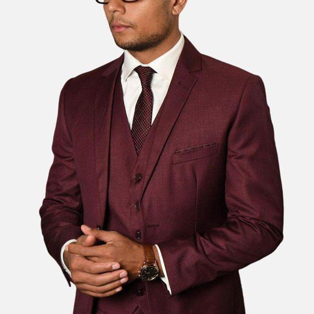 man in glasses wearing burgundy suit