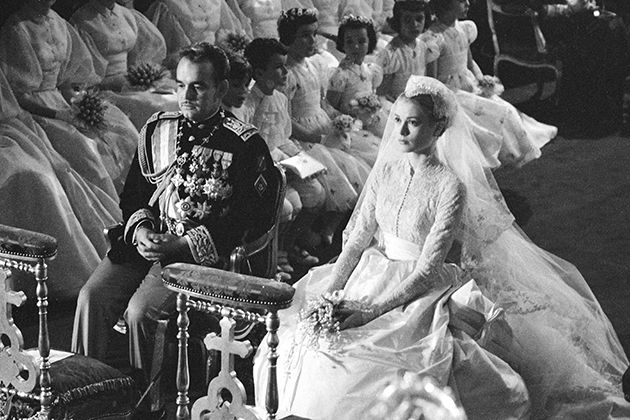 Prince Rainier and Grace Kelly seated at their wedding ceremony