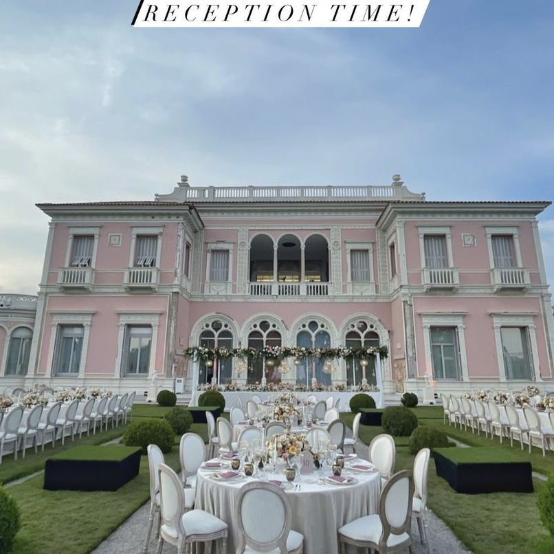 reception set up in front of stately pink home