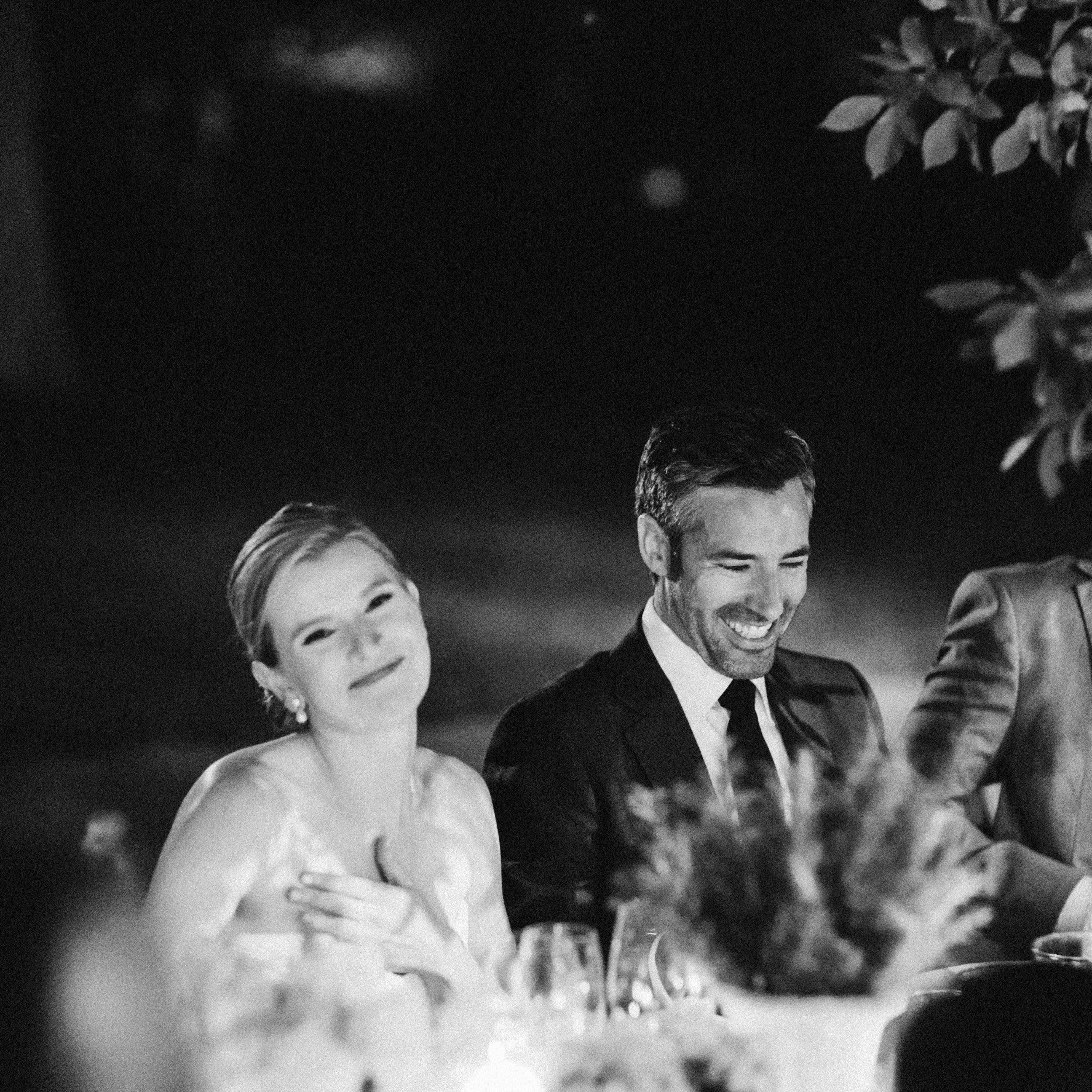 couple laughing at reception
