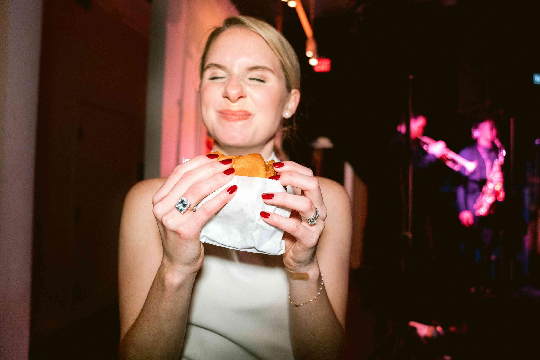 bride eating a cheeseburger