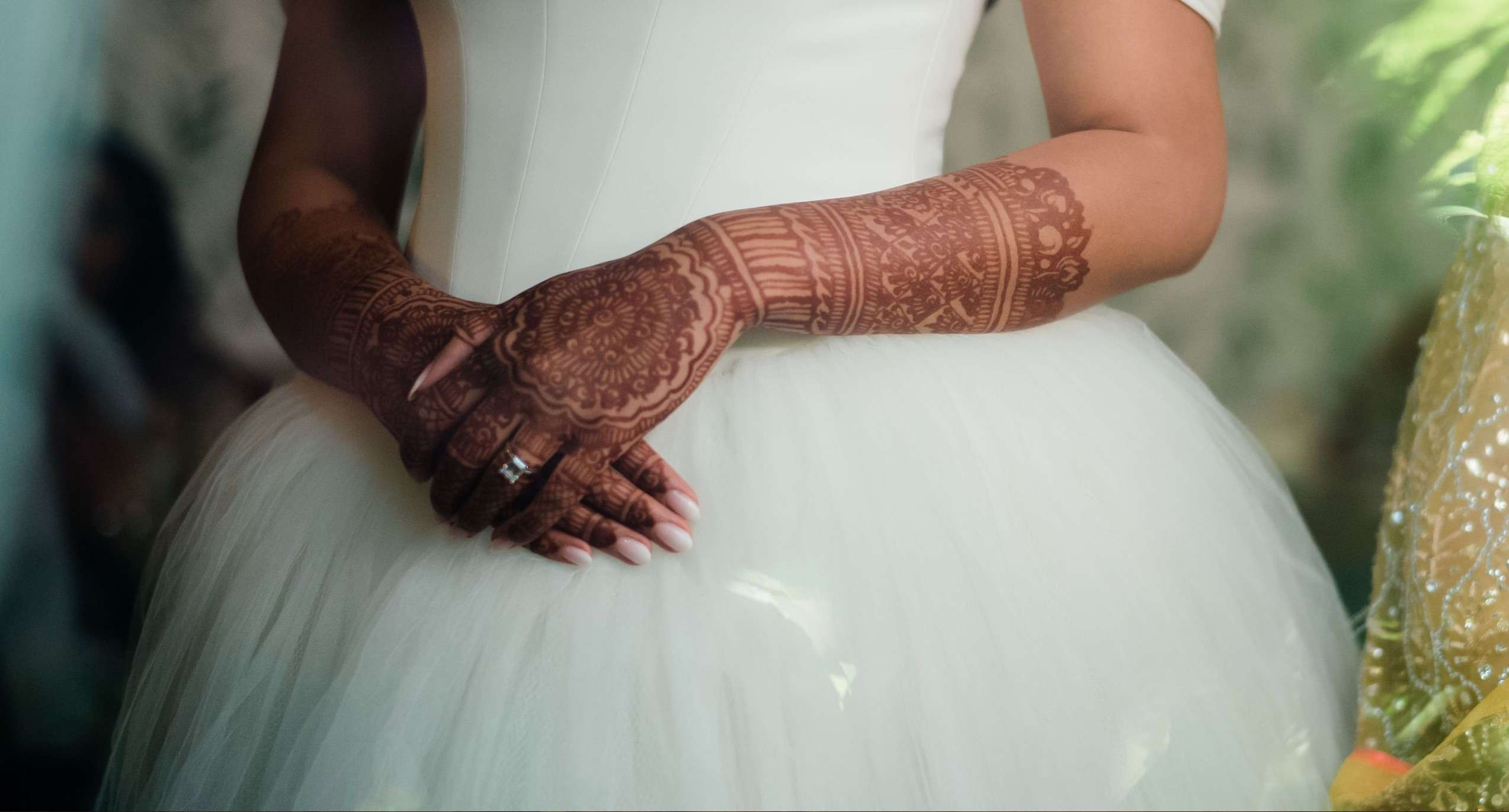 Bride with henna tattoos and an ombre manicure