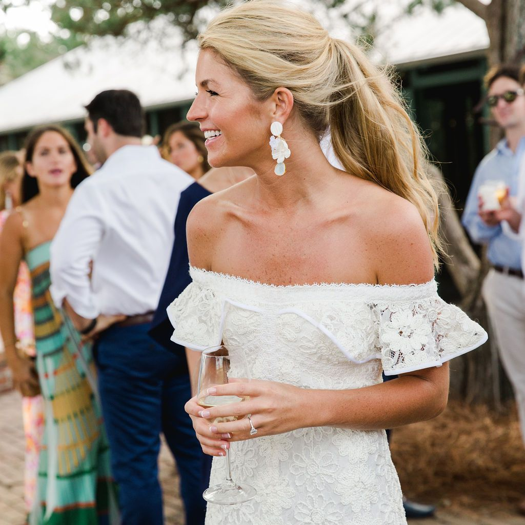 timeless southern wedding, bride jumpsuit statement earrings
