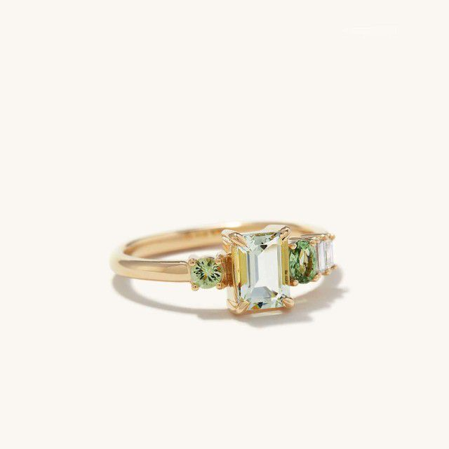 cluster ring with green sapphires