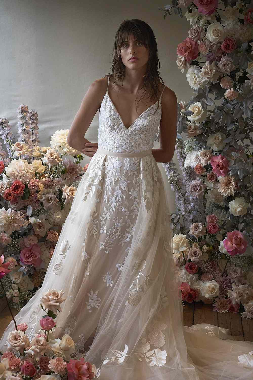 Model in spaghetti strap A-line wedding dress