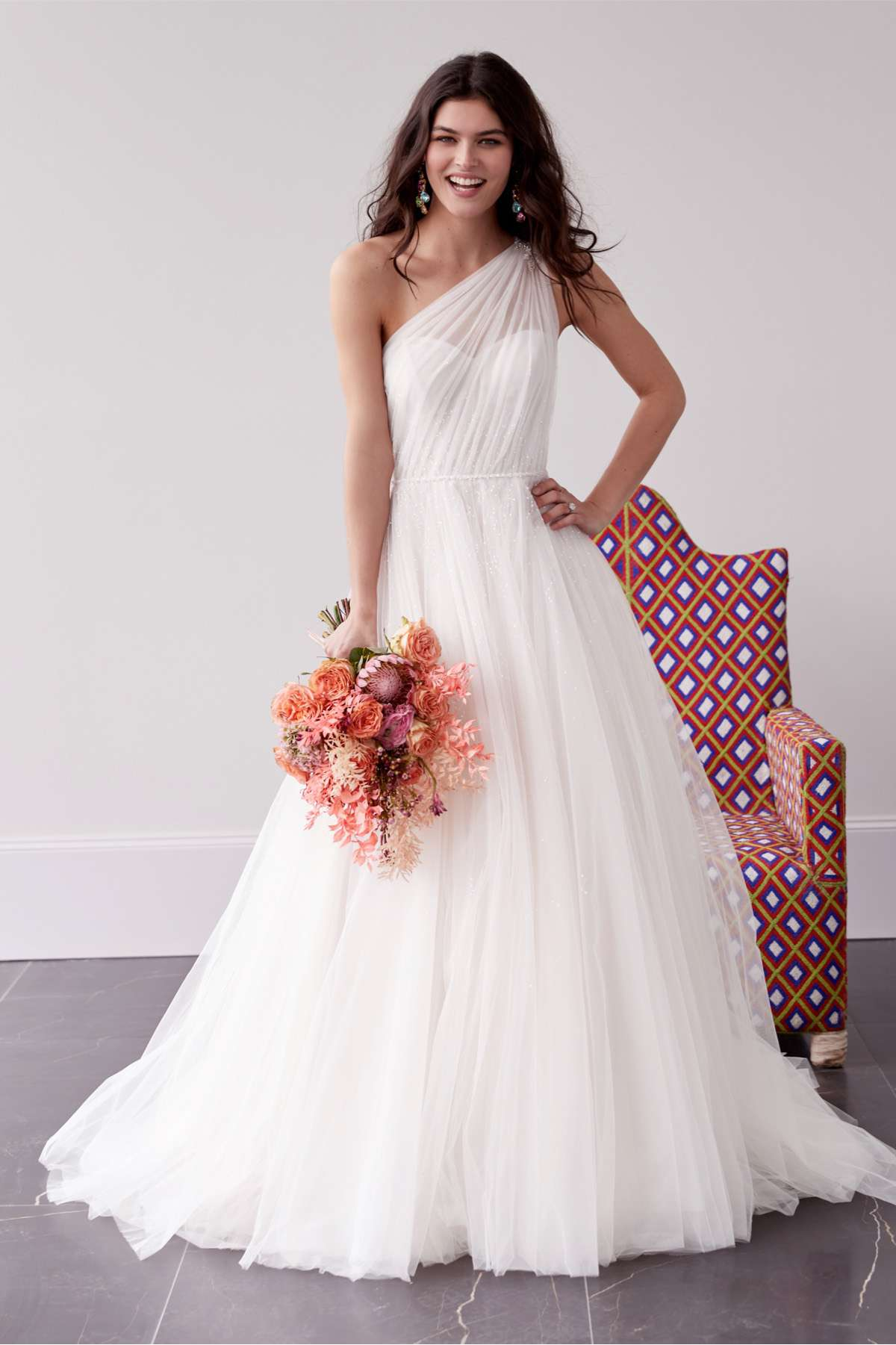 Model in on-shouldered tulle ballgown