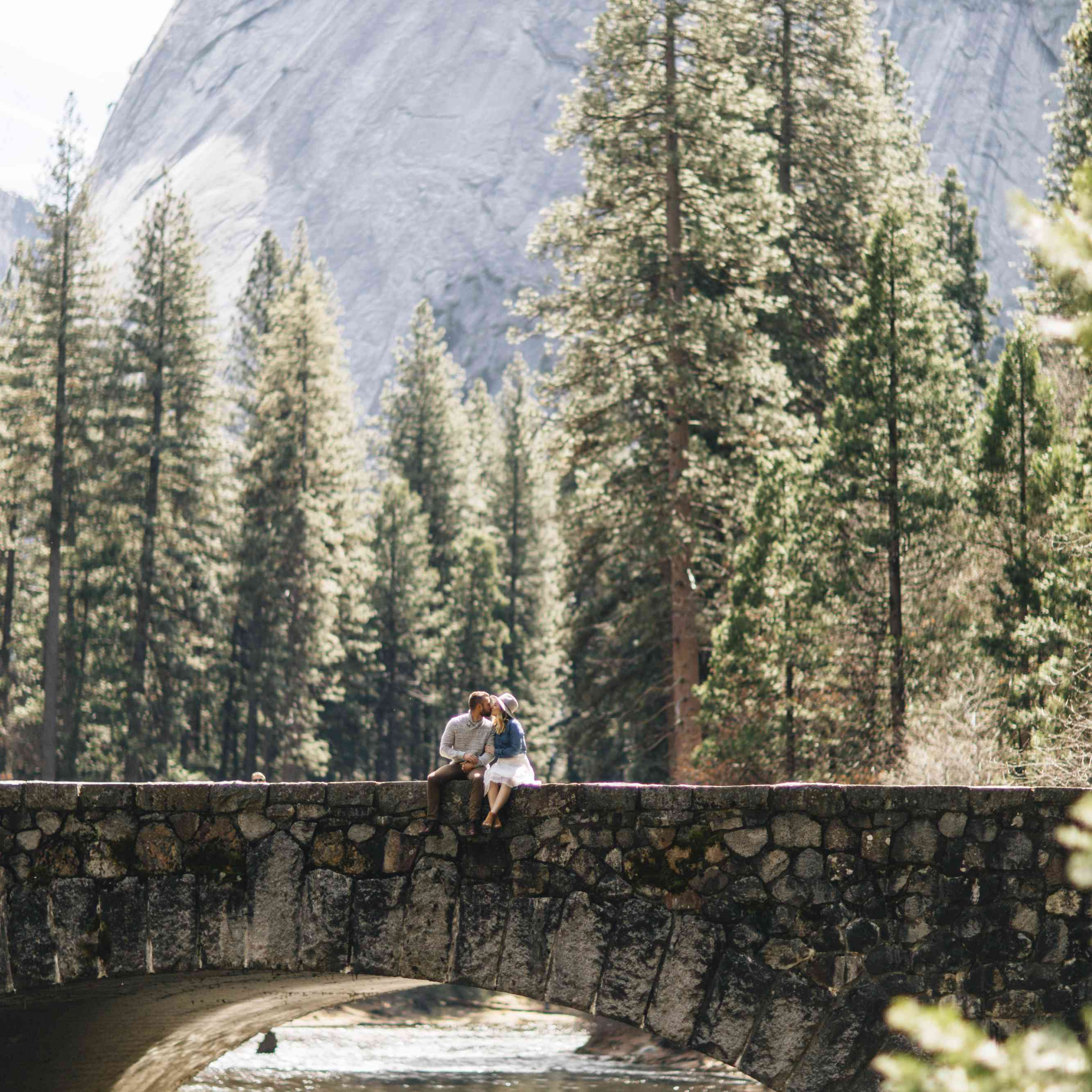 Couple on a bride in the forest and mountains of Yosemite