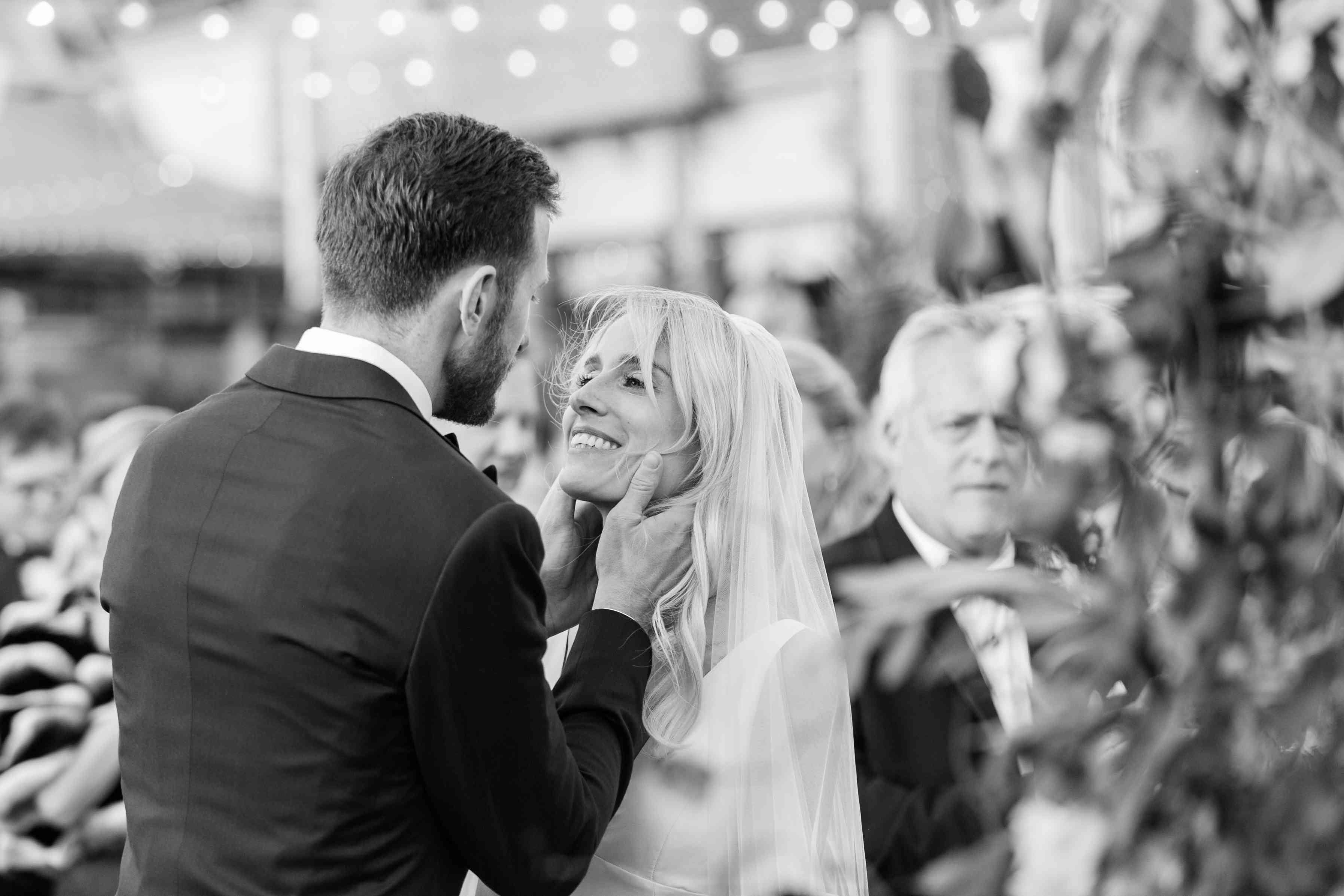 <p>couple looking at each other holding her face</p><br><br>