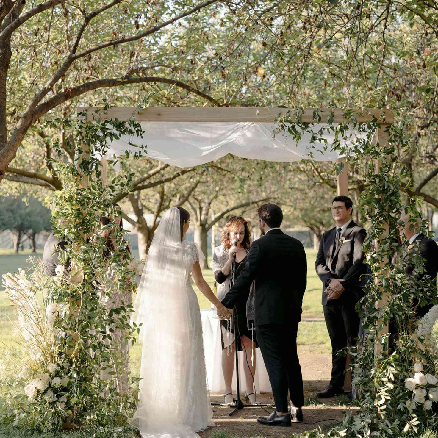 Bride and groom at the altar with woman officiant