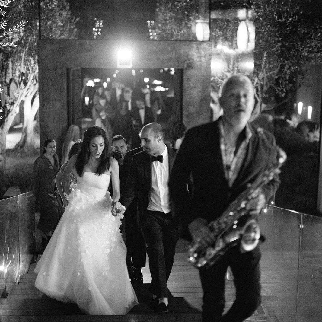 bride and groom and saxophone player