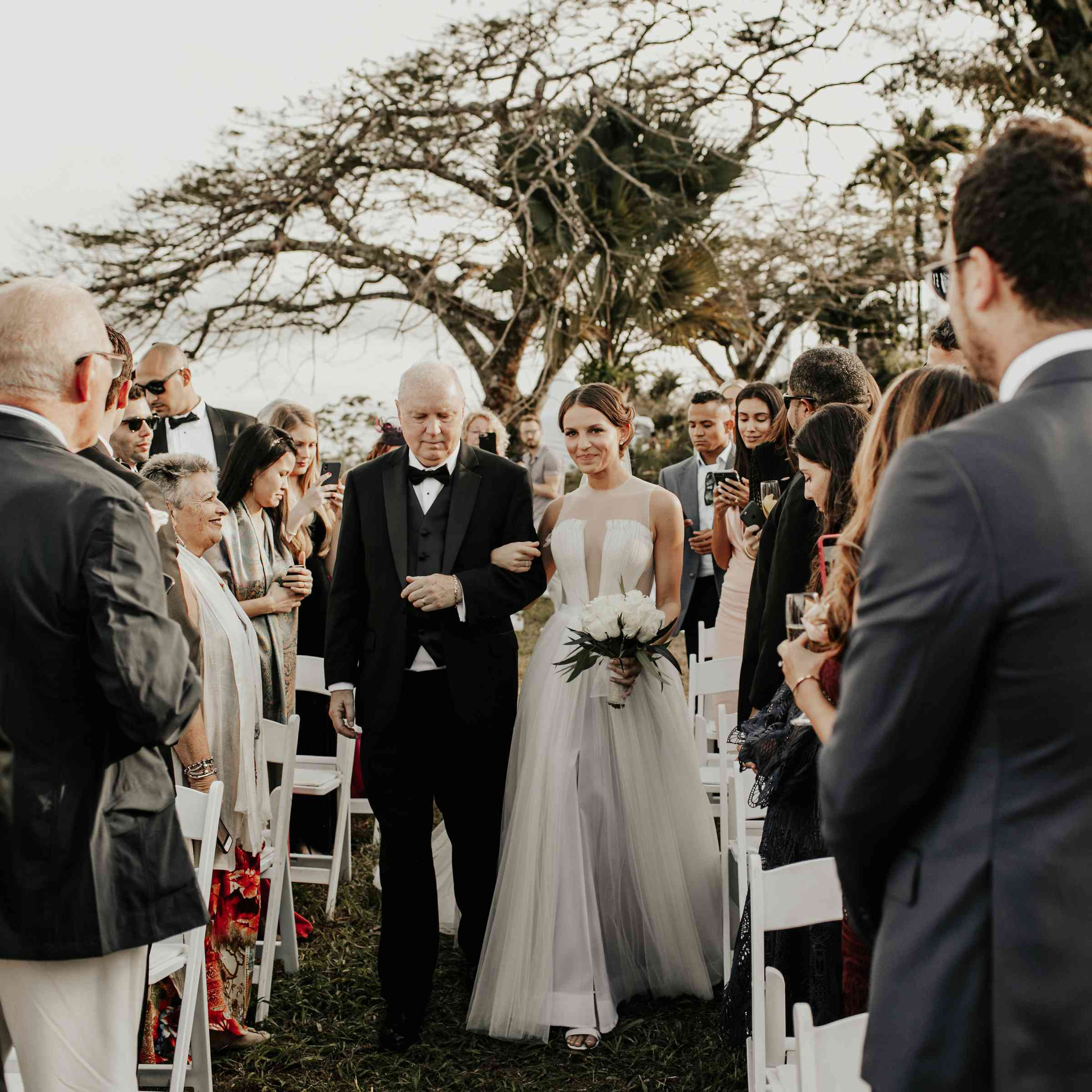 father walking bride down the aisle