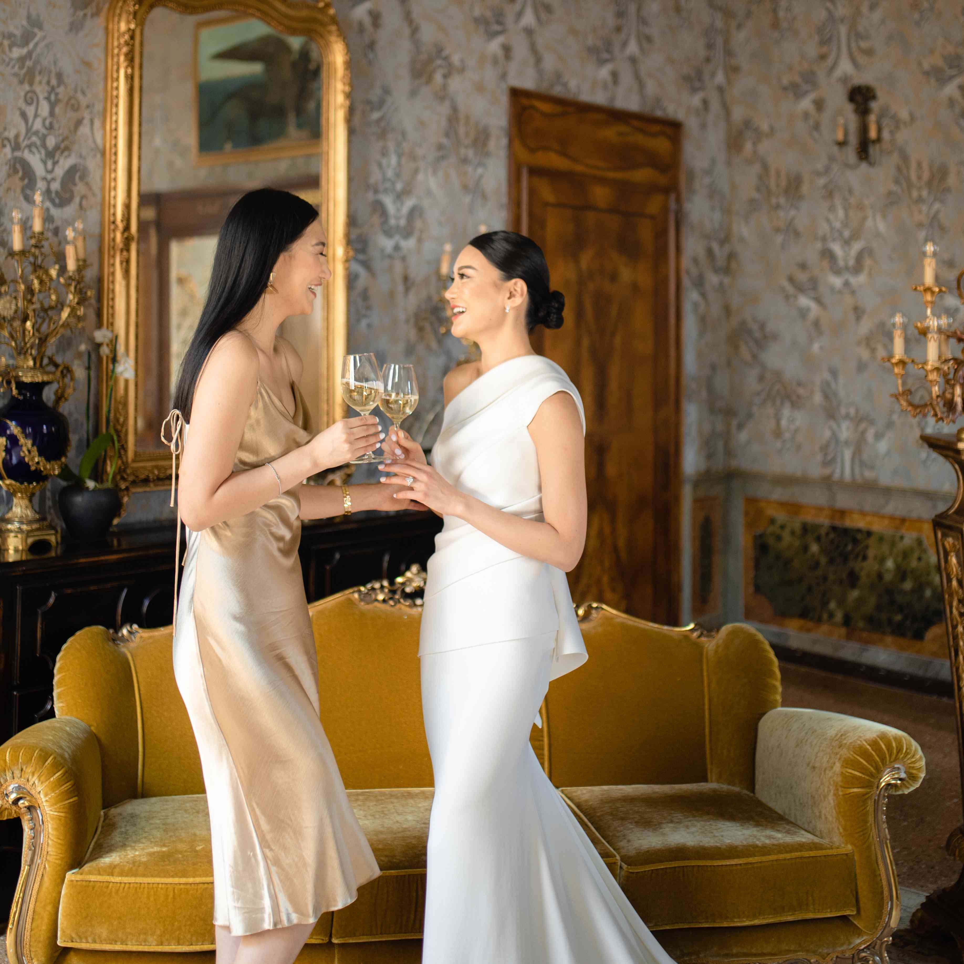 modern venice wedding, bride drinking wine with bridesmaid