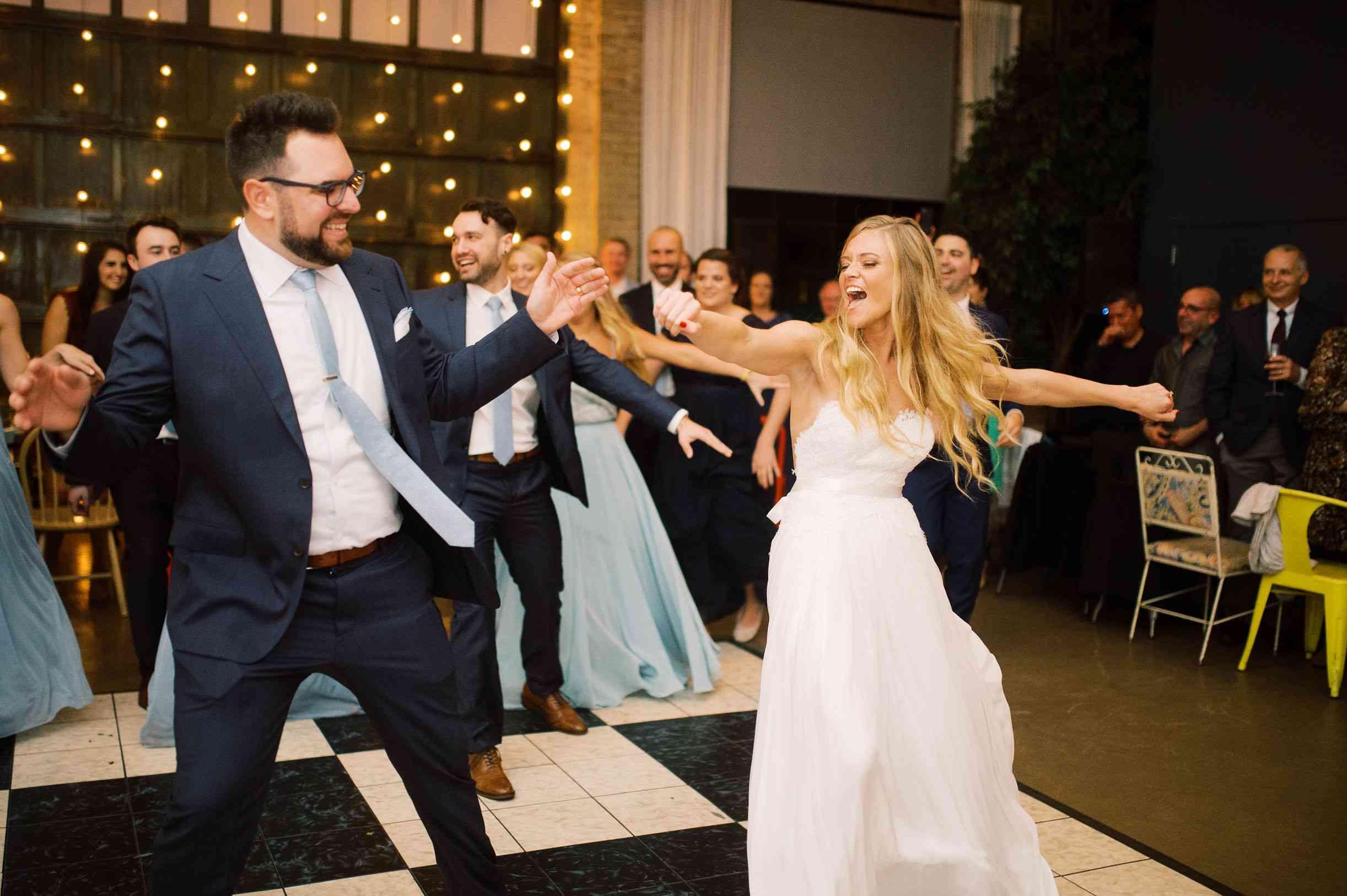 whimsical savannah wedding, bride and groom dancing flash mob