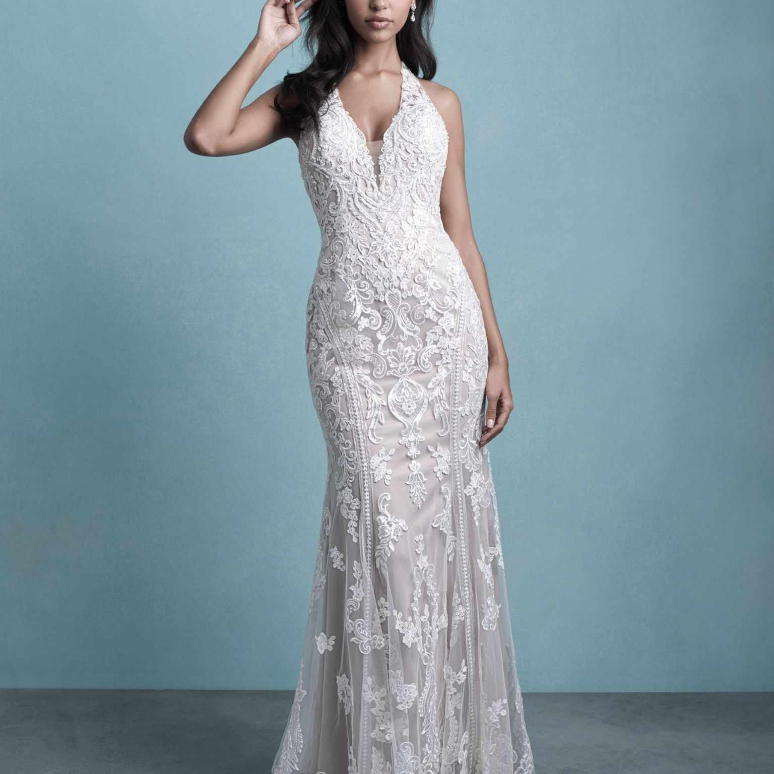 Model in beaded illusion wedding gown