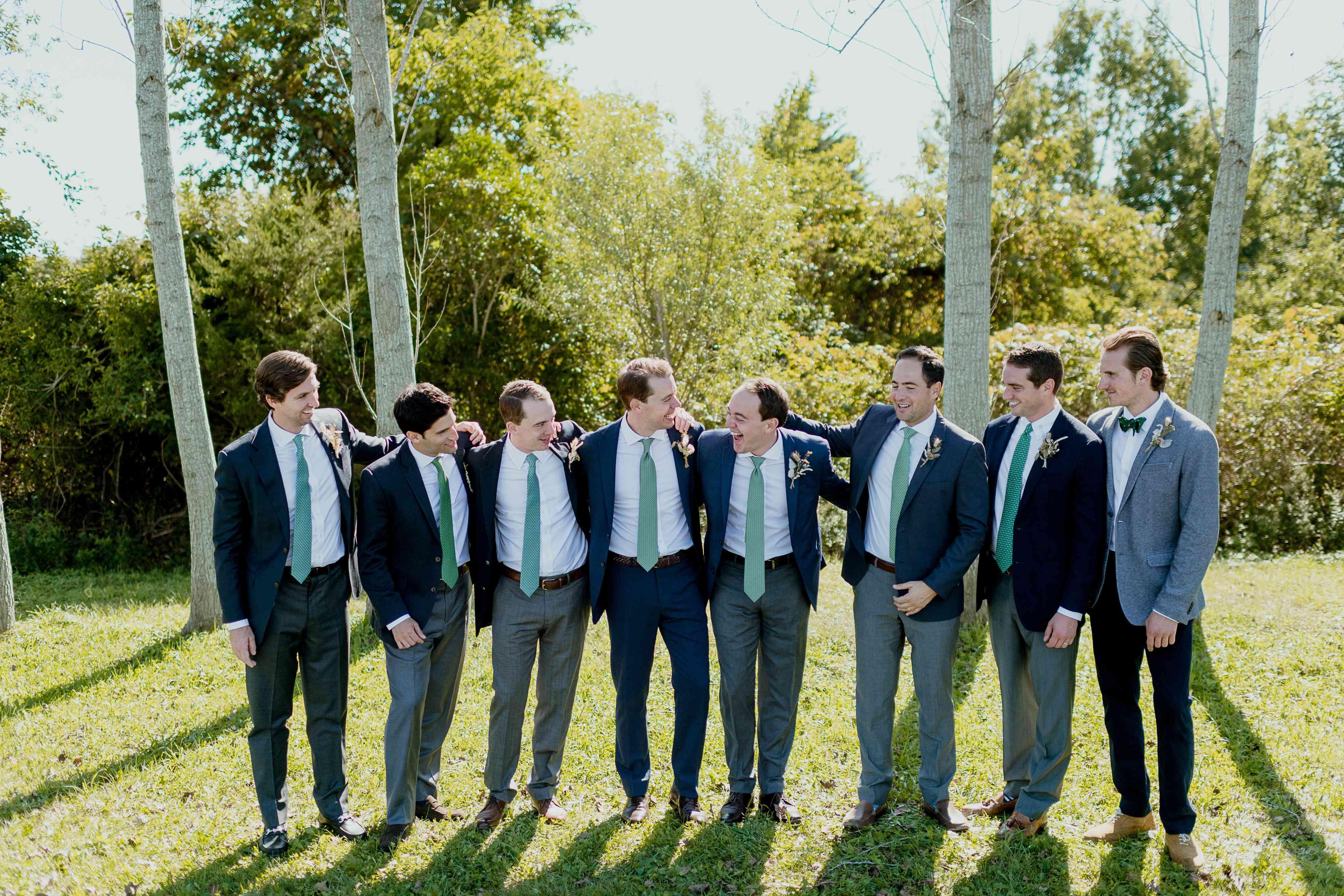 groomsmen in navy blazers