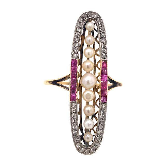 oval decorative ring with pearl, diamond, and ruby details