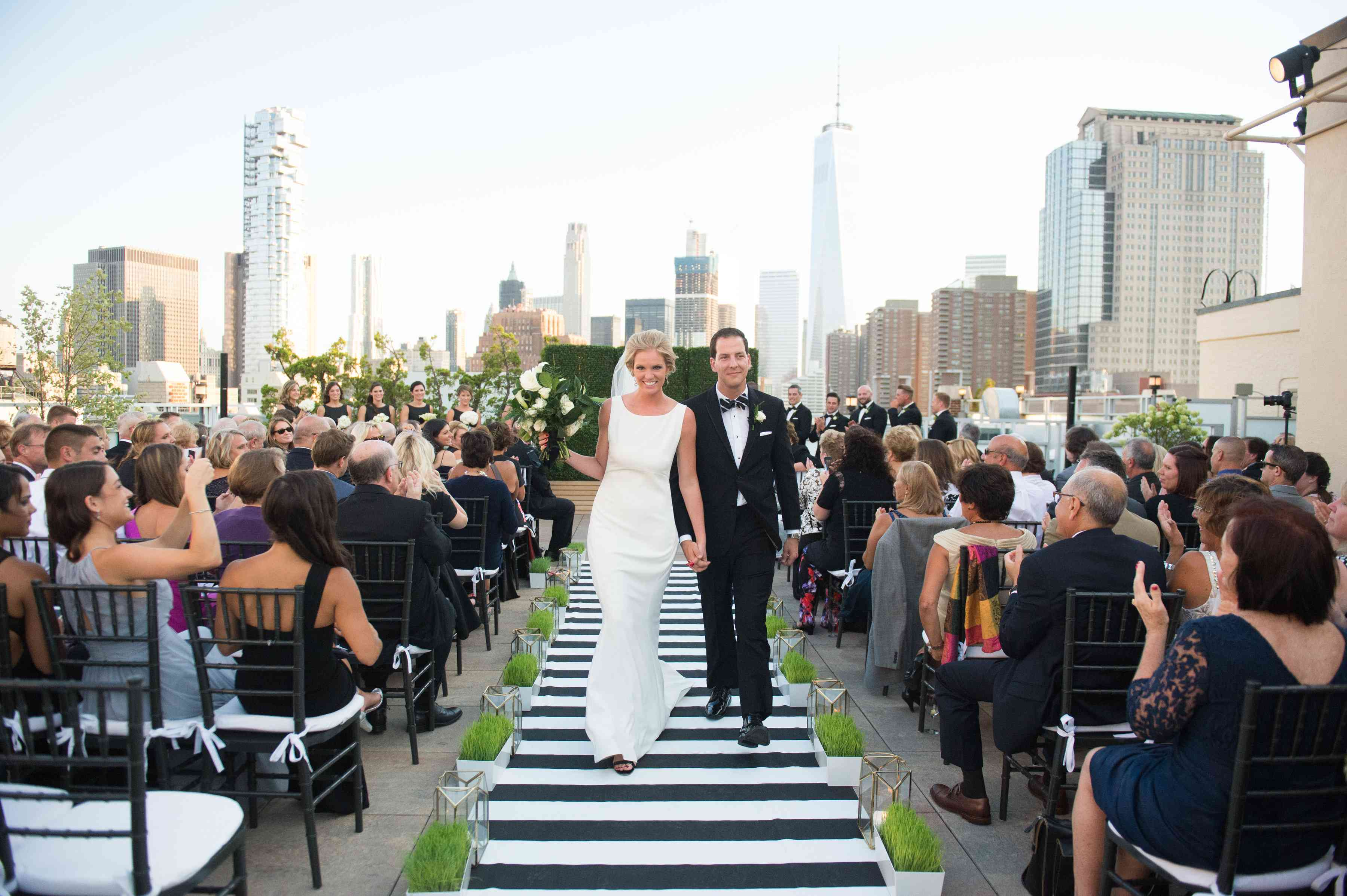 Bride and groom leaving aisle
