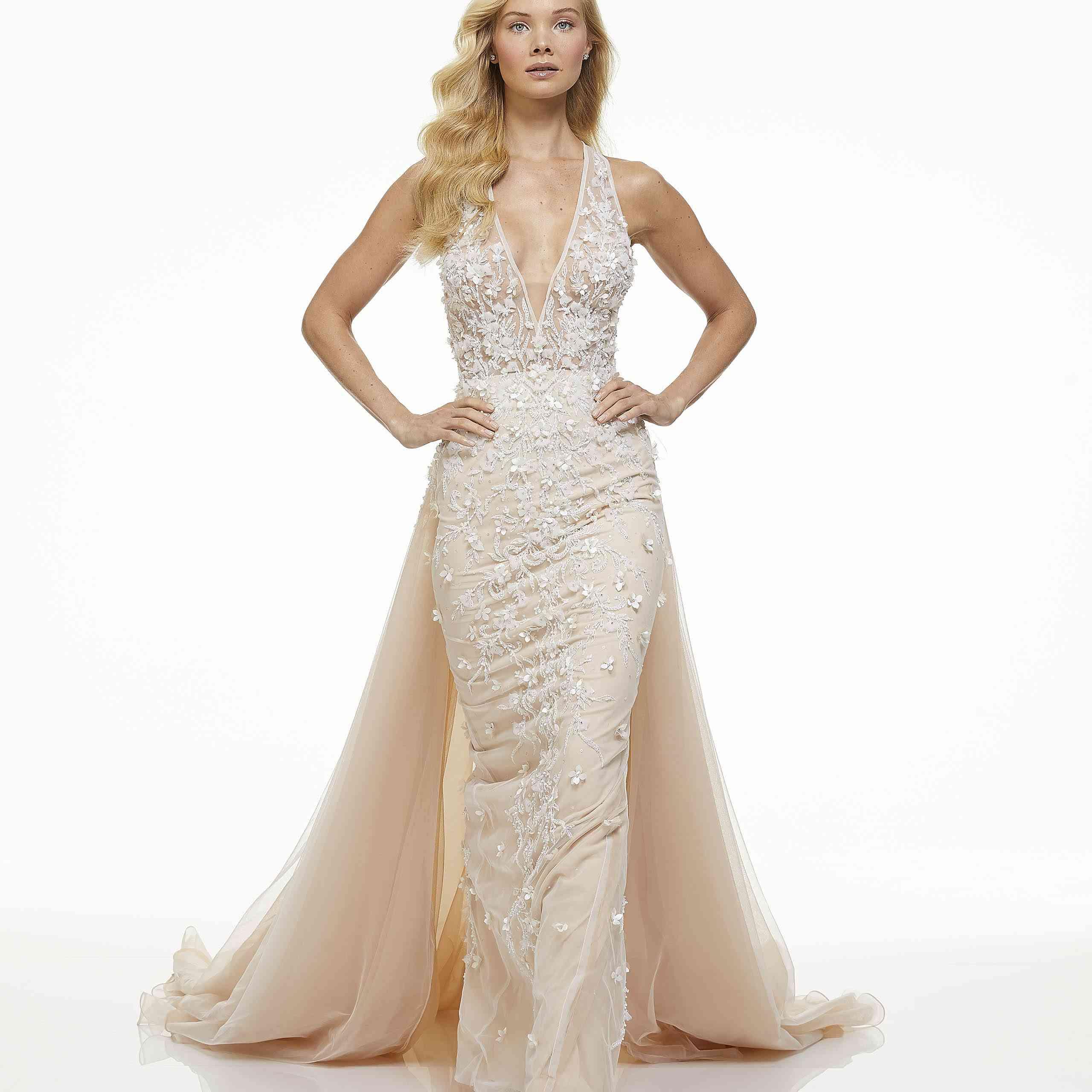 Model in blush halter column wedding down