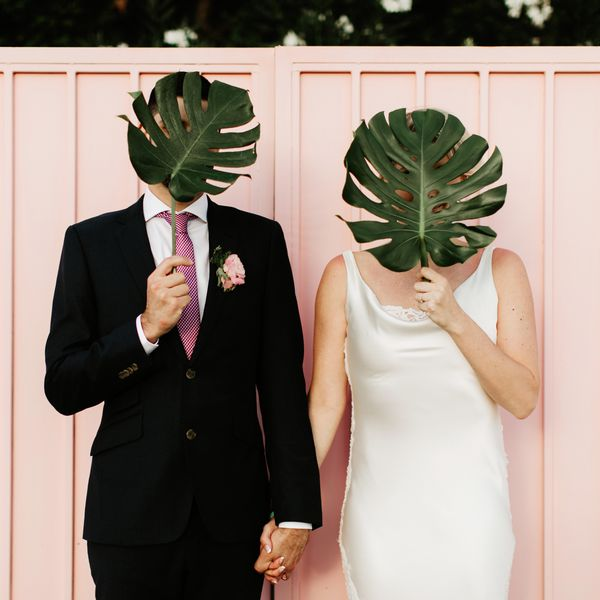 Bride and groom with tropical leaves