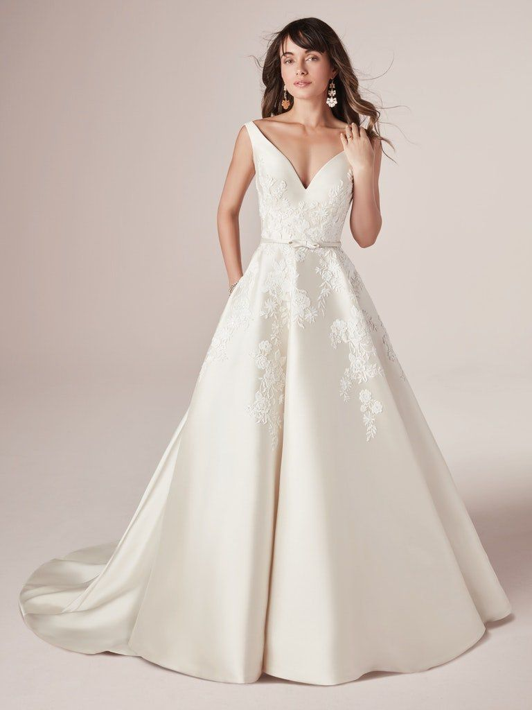 Model in long A-line wedding gown with pockets