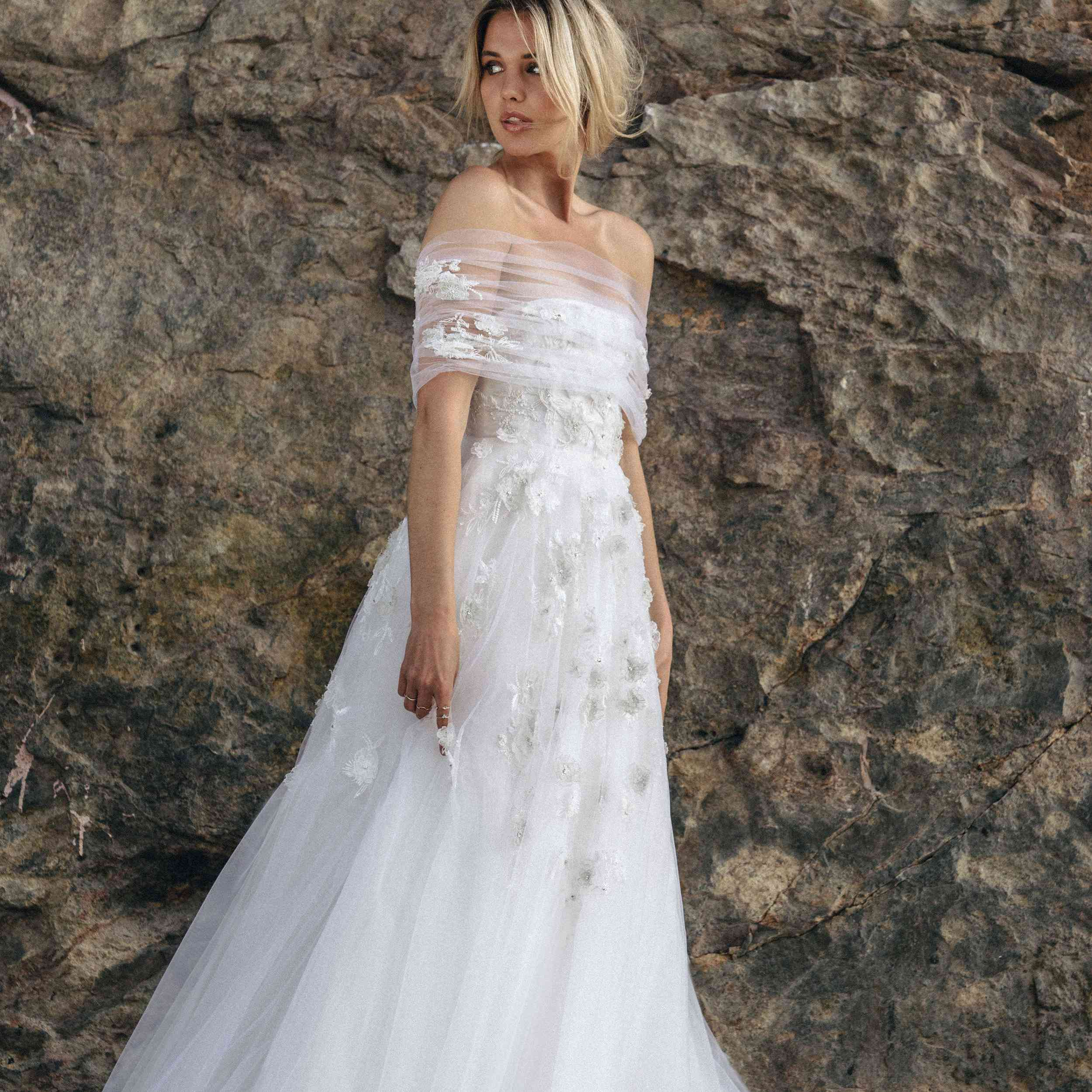 Model in tulle off-the-shoulder dress with floral applique