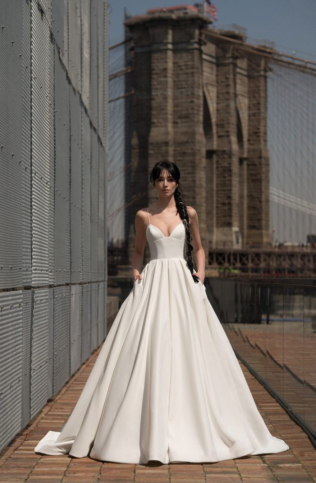 Model in corset waist ballgown with pockets