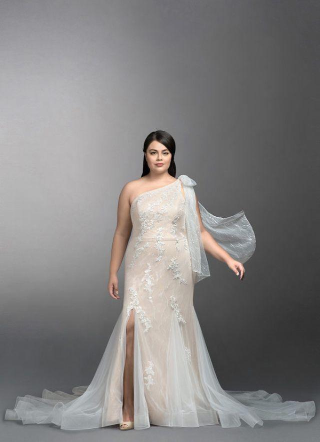 Plus size model in one-shoulder mermaid gown