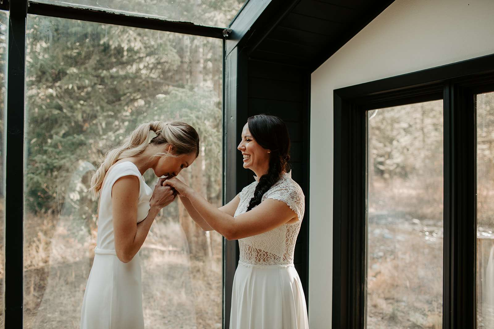 Brides kiss before ceremony
