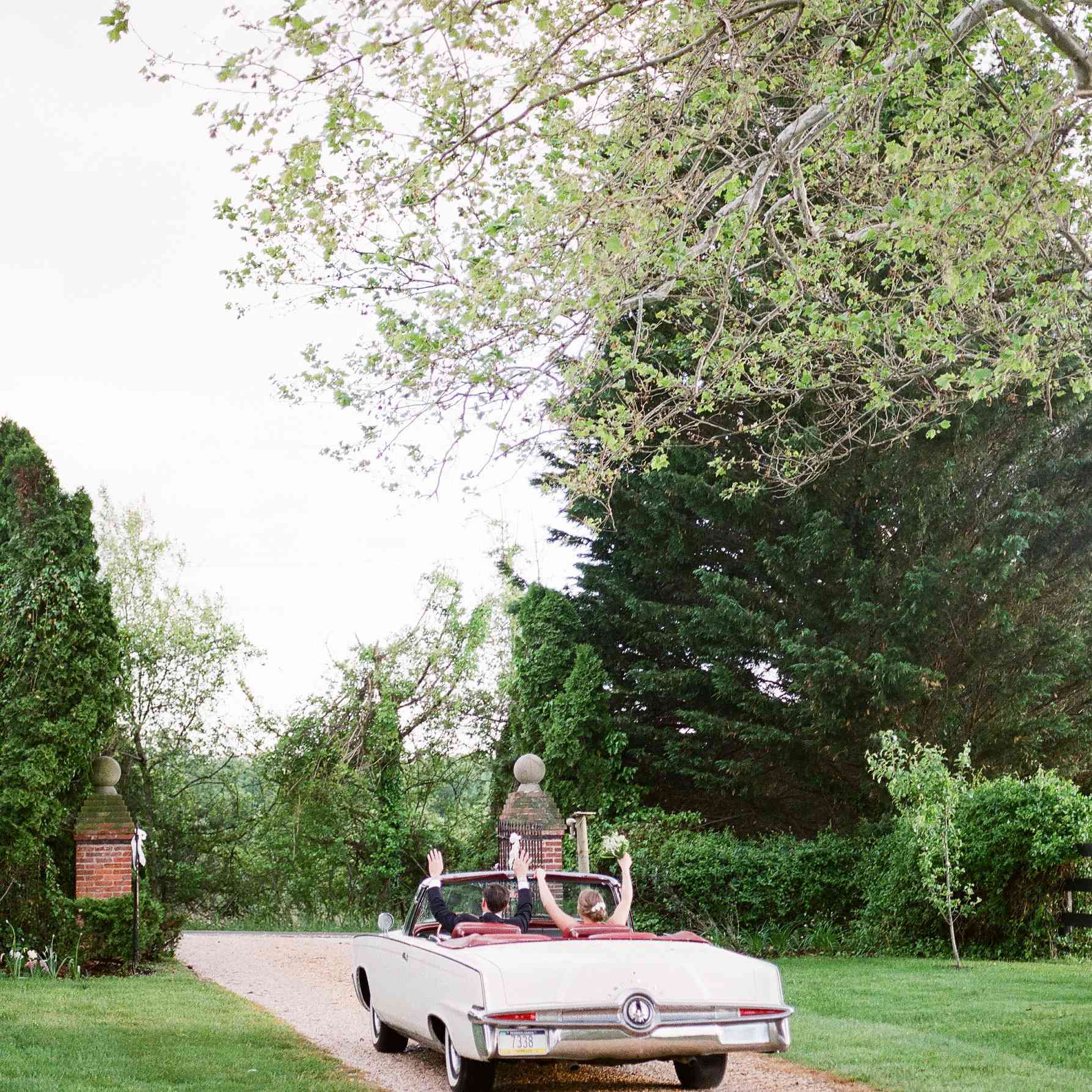 Bride and groom in convertible