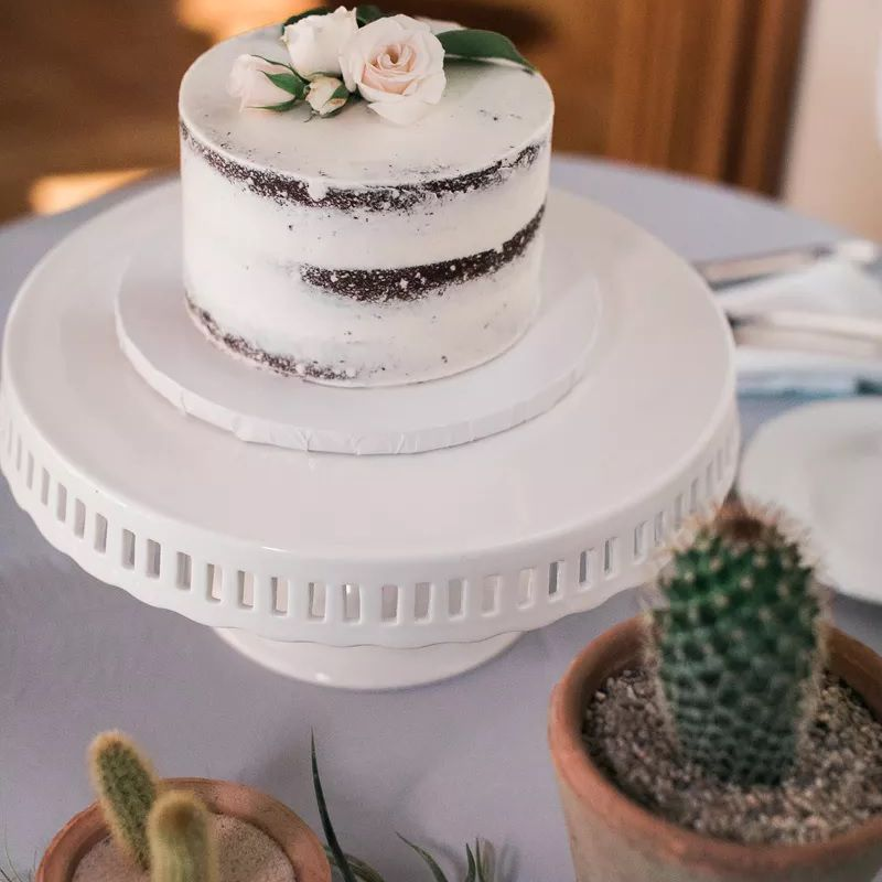 Single layer naked cake with subtle florals