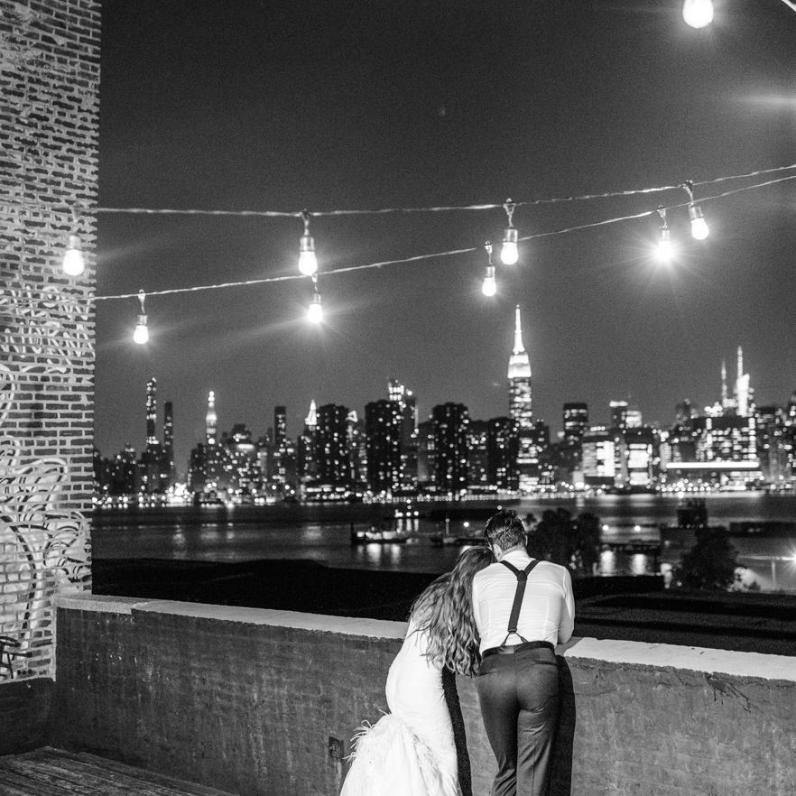 <p>Bride and groom looking over nyc skyline</p><br><br>