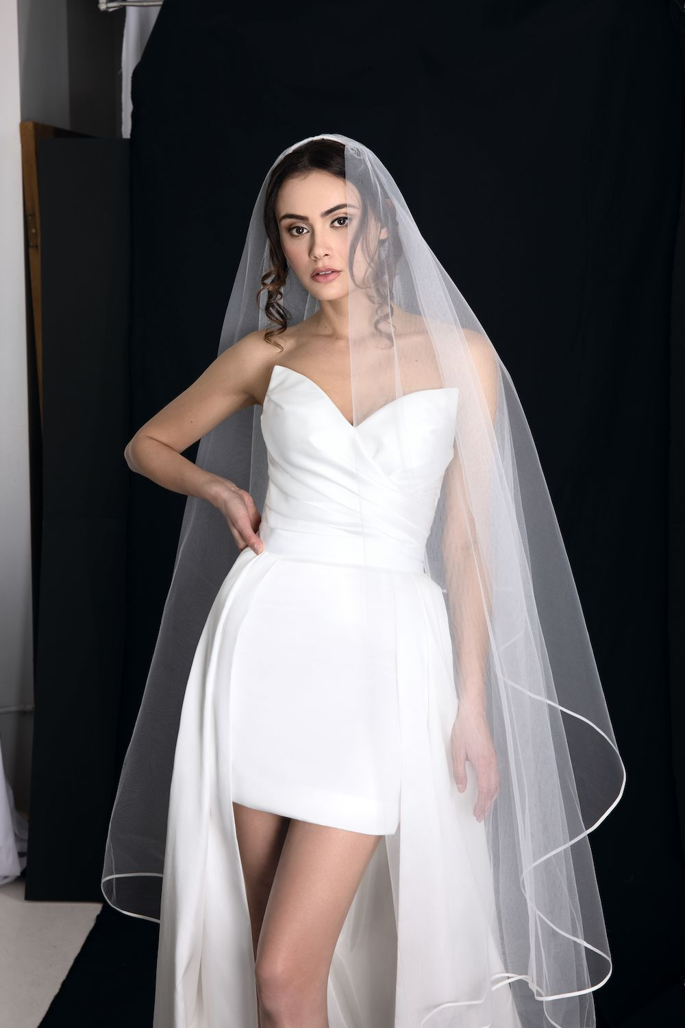 woman wearing minidress with bridal veil