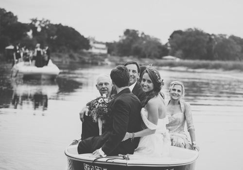 Wedding Party Arriving By Boat