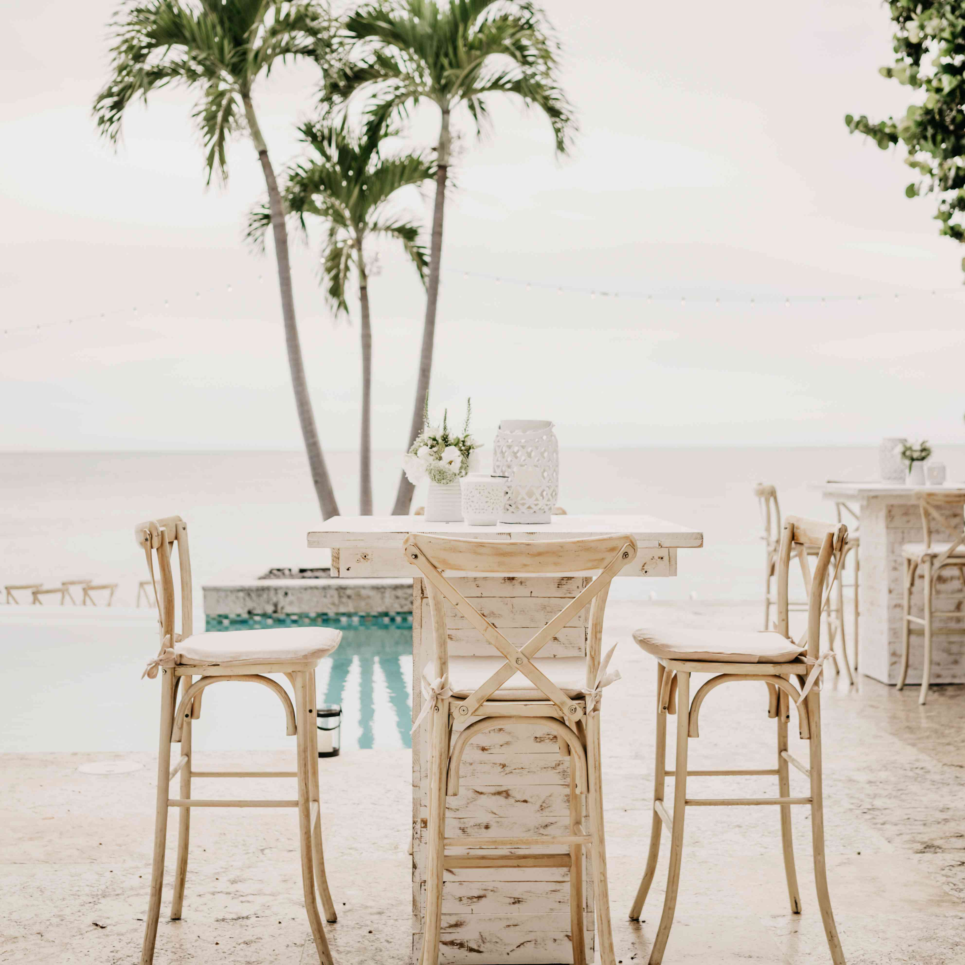 Simple table setting at an outdoor wedding by the beach