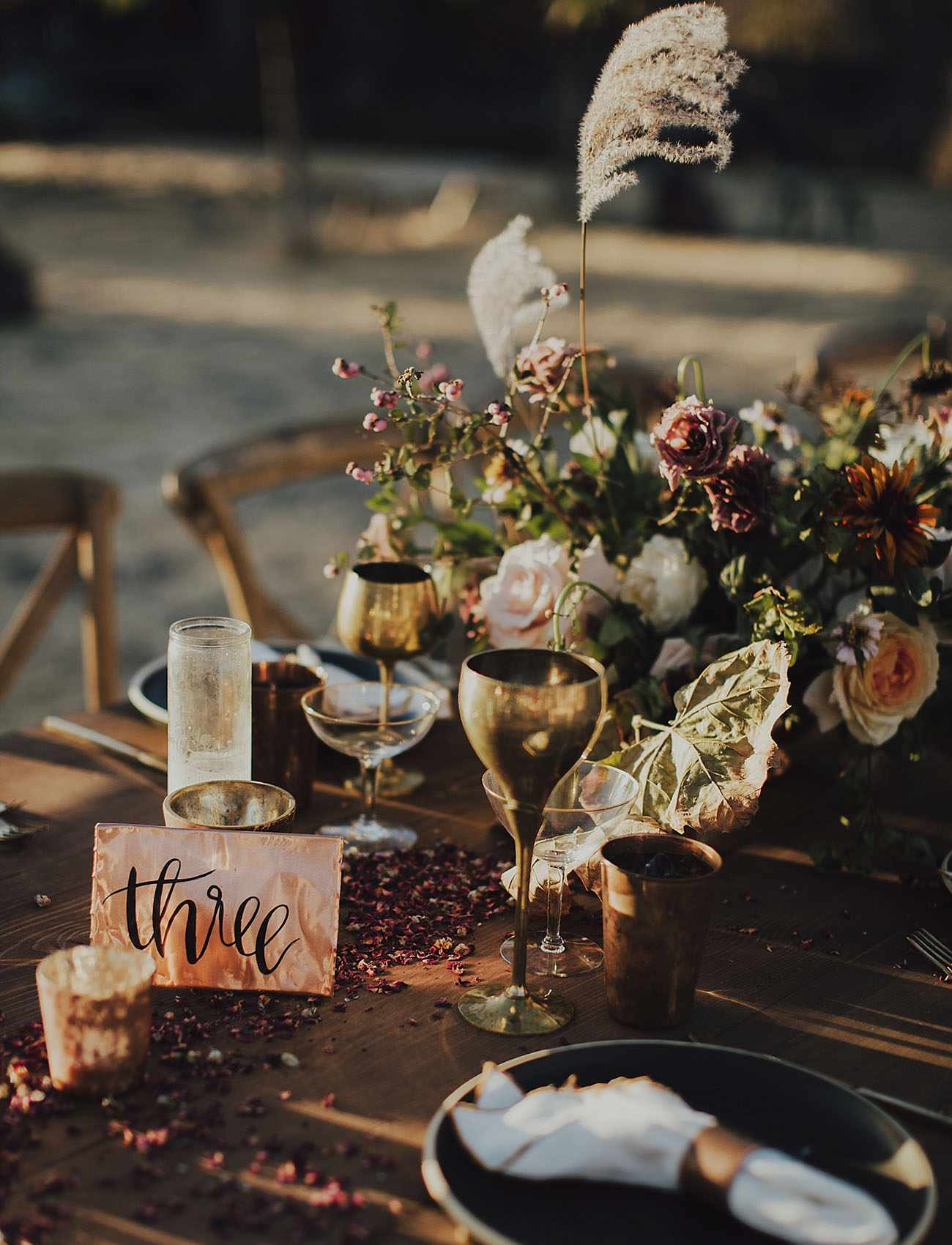 Calligraphy table sign at wedding reception.